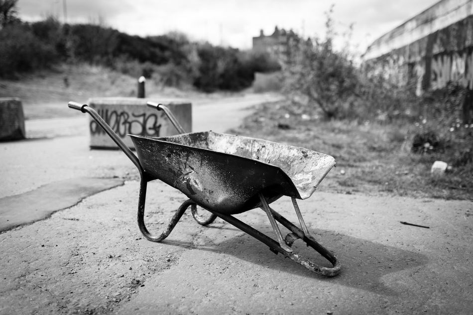 35mm Black And White Black And White Photography Blackandwhite Building Canon Canon5Dmk3 Canonphotography City Close-up Construction Construction Site Day Dirt Focus On Foreground Grime Monochrome No People Outdoors Sigma Still Life StillLifePhotography Urban Urban Landscape Wheelbarrow