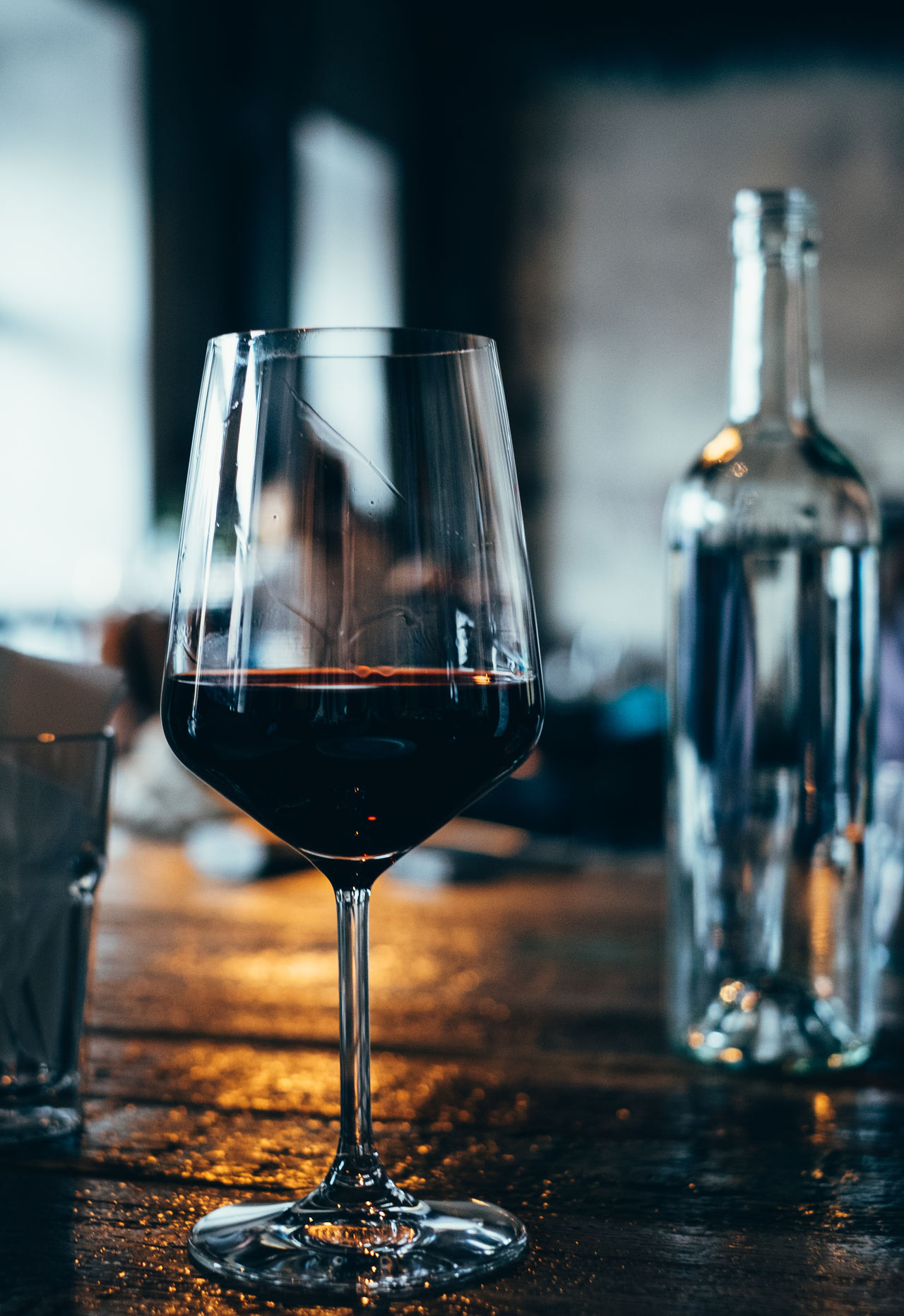 glass of red wine in a bar Alcohol Close-up Day Drink Focus On Foreground Food And Drink Freshness Half Full Indoors  No People Red Wine Table Wine Winebar Wineglass Winetasting