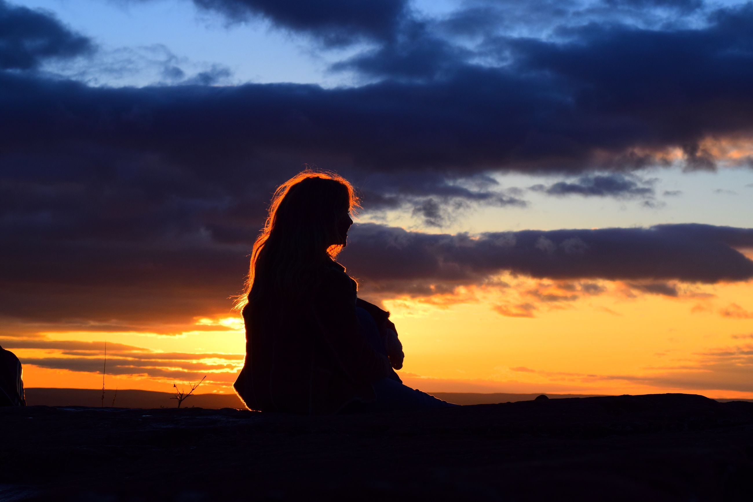 cloud - sky, sunset, sky, one person, sitting, young adult, one woman only, only women, relaxation, nature, adult, sea, outdoors, people, women, dreamlike, silhouette, adults only, leisure activity, one young woman only, beauty in nature, day