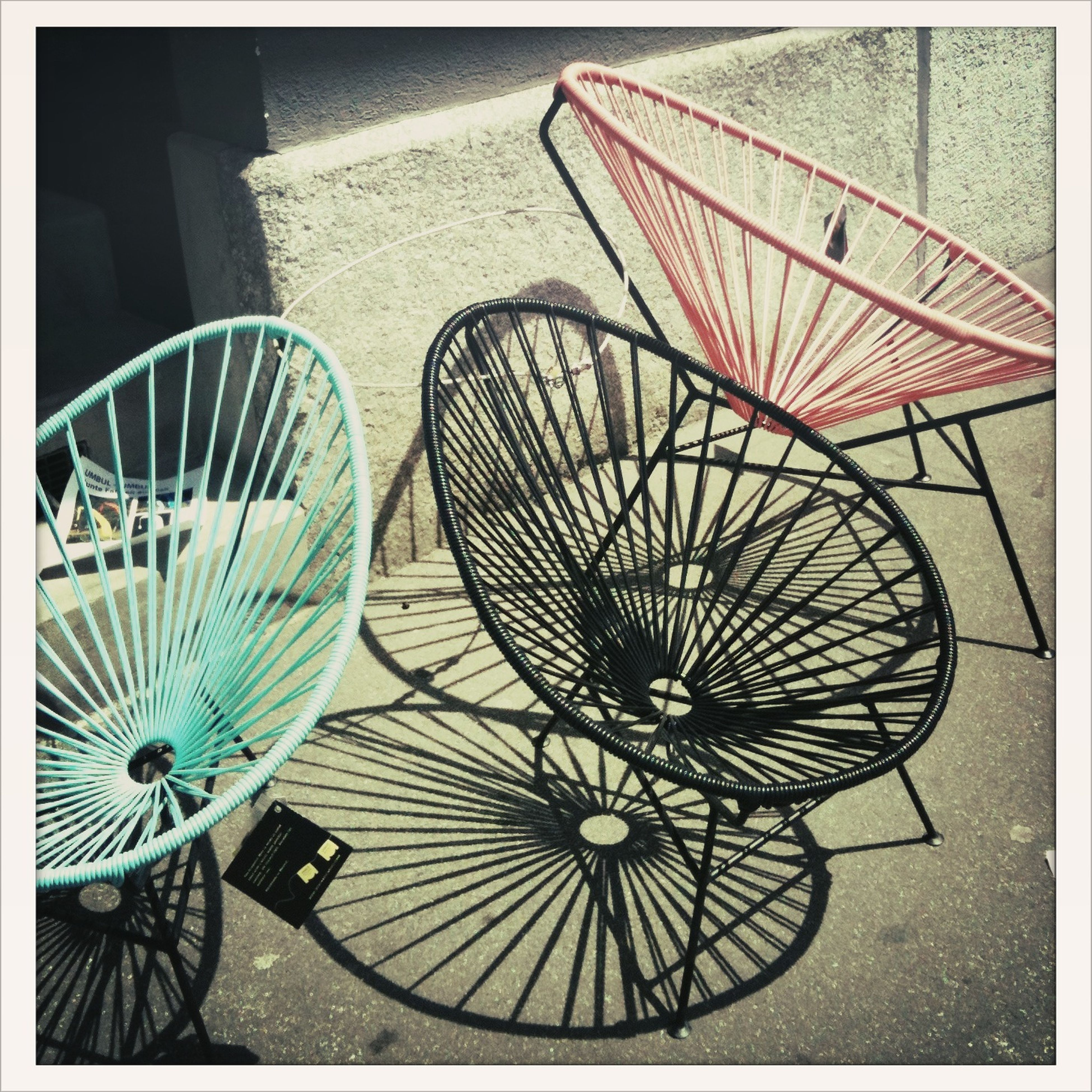 transfer print, auto post production filter, absence, bicycle, table, still life, chair, wheel, high angle view, no people, empty, indoors, sunlight, shadow, day, pattern, seat, stationary, basket, multi colored