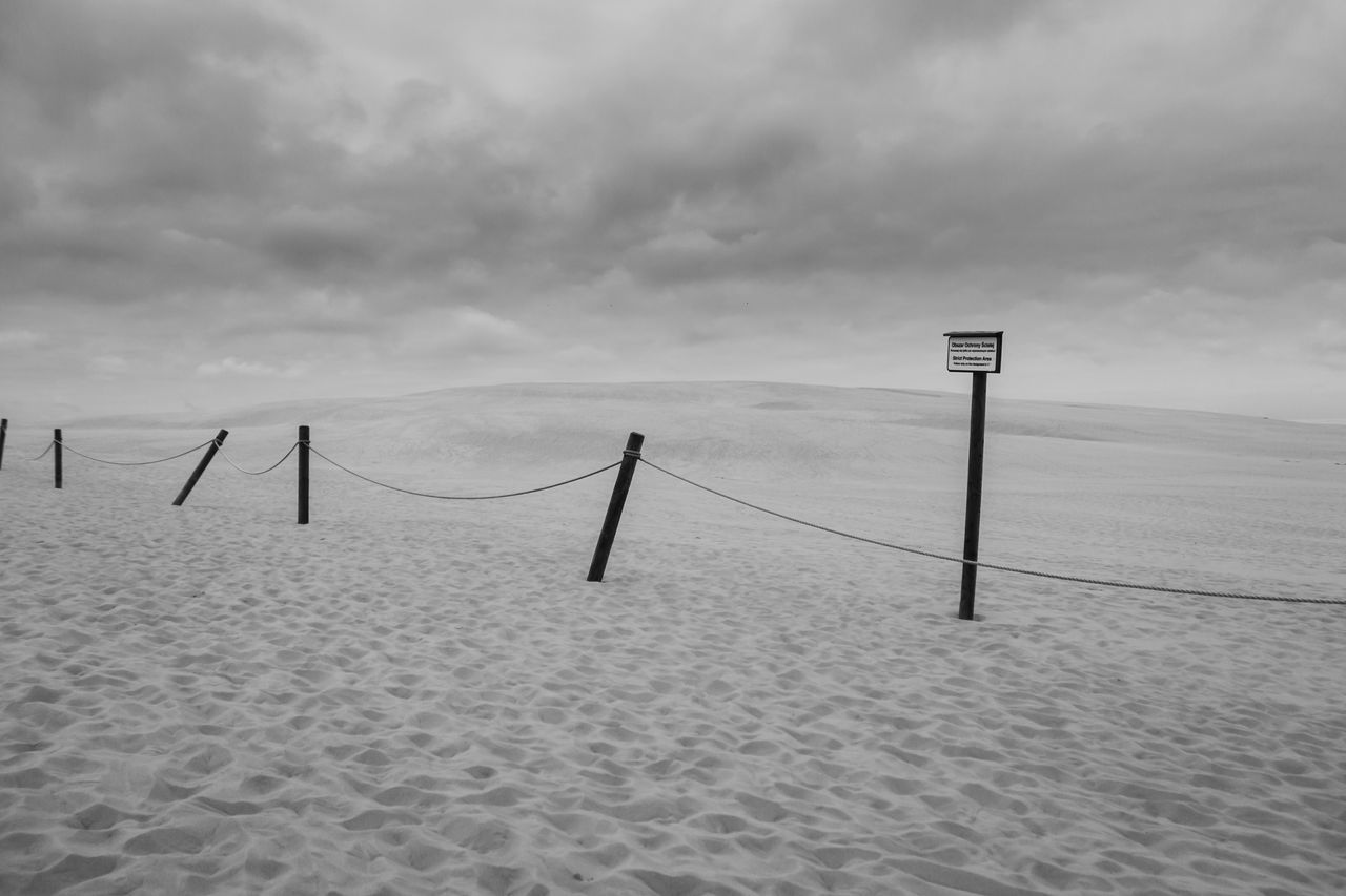 Tranquility Sky Scenics Sand Travel Destinations Wooden Post Cloud - Sky Non-urban Scene Outdoors Black And White No People Minimalism Nature National Park Słowiński Park Narodowy