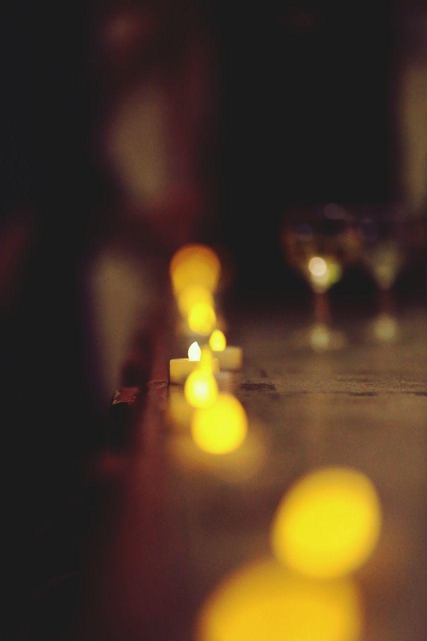 Row Of Burning Candles On Ledge