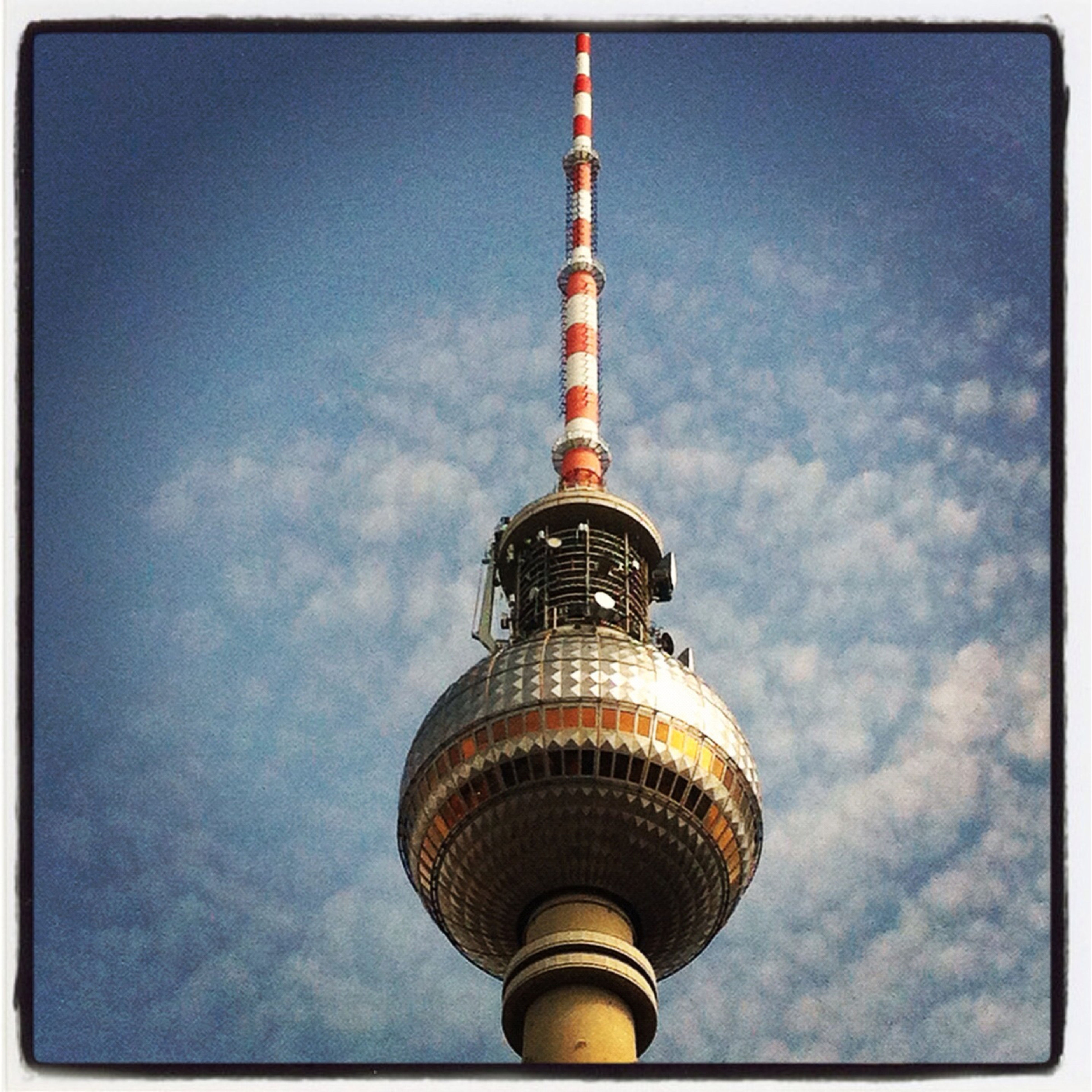 low angle view, architecture, communications tower, built structure, tower, tall - high, building exterior, transfer print, sky, international landmark, famous place, television tower, travel destinations, capital cities, spire, tourism, communication, fernsehturm, culture, travel