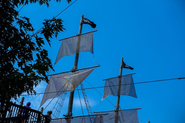 Alternative Energy Blue Blue Sky Clear Sky Day Environmental Conservation Flag Growth High Section Low Angle View Nature No People Outdoors Pirate Pirate Ship Pirates Pirateship  Renewable Energy Sky Tall - High Wind Power Windmill