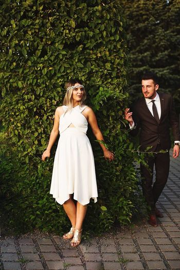 Two People Couple - Relationship Outdoors Well-dressed People Hideandseek Engagement Photography Couple Love Together Forever Together Relationship Young Couple In Love Young Couple Engaged