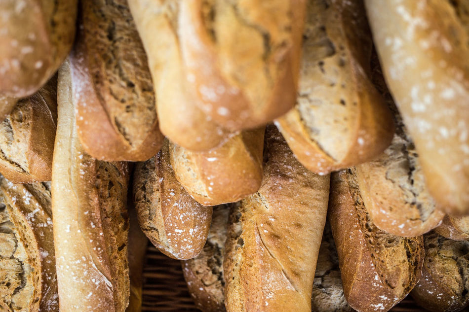 french baguettes on a market Baguette Baked Bakery Blur Blurry On Purpose Bread Breads Brown Close-up Cultures Depht Of Field Eye4photography  EyeEm Best Shots EyeEm Gallery Food French Food Freshness Full Frame Group Of Objects Large Group Of Objects Loaf Of Bread Market Ready-to-eat Retail