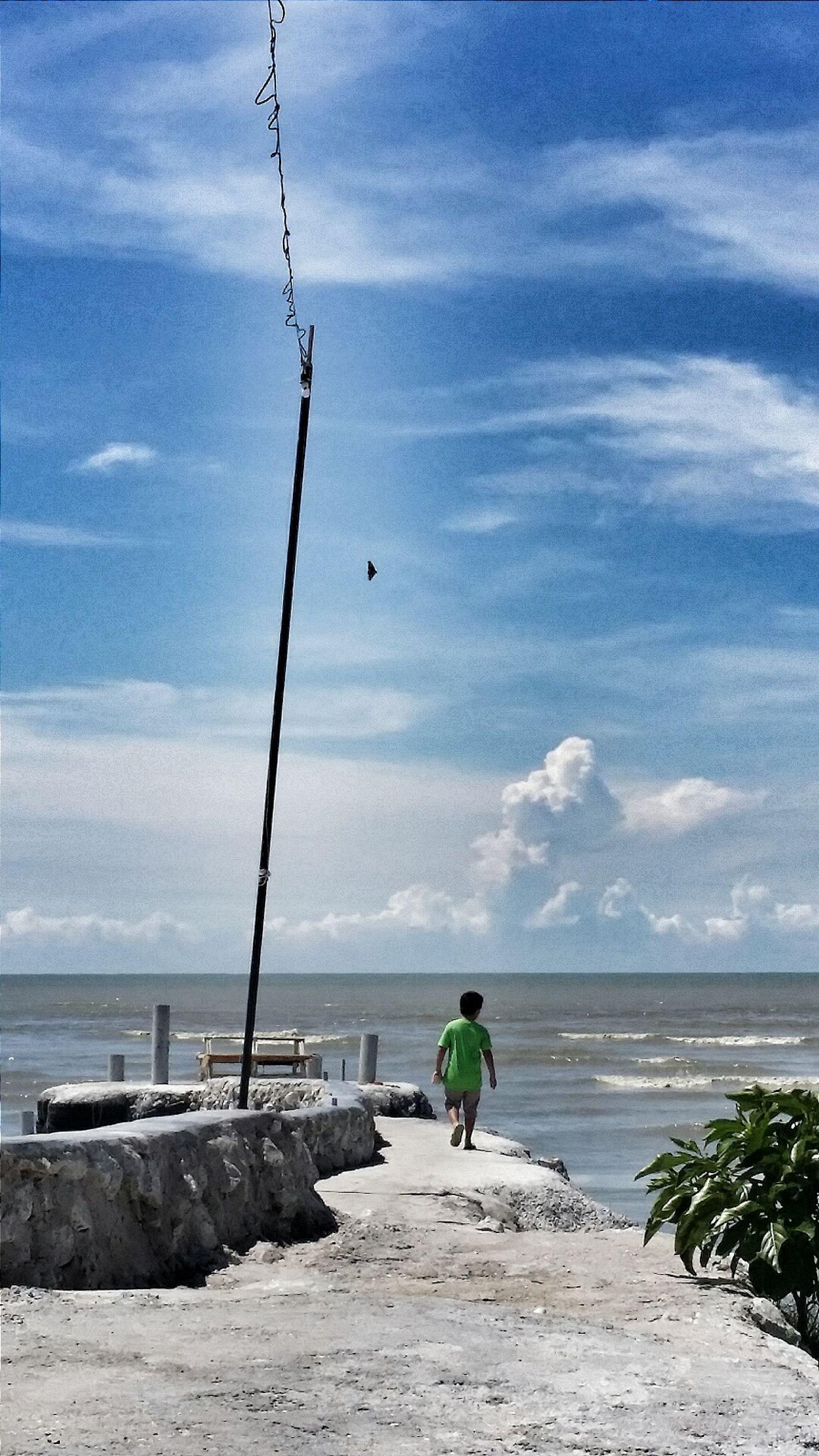 Beautiful Day Child Bkue Skies Beach At Sekinchan, Malaysia