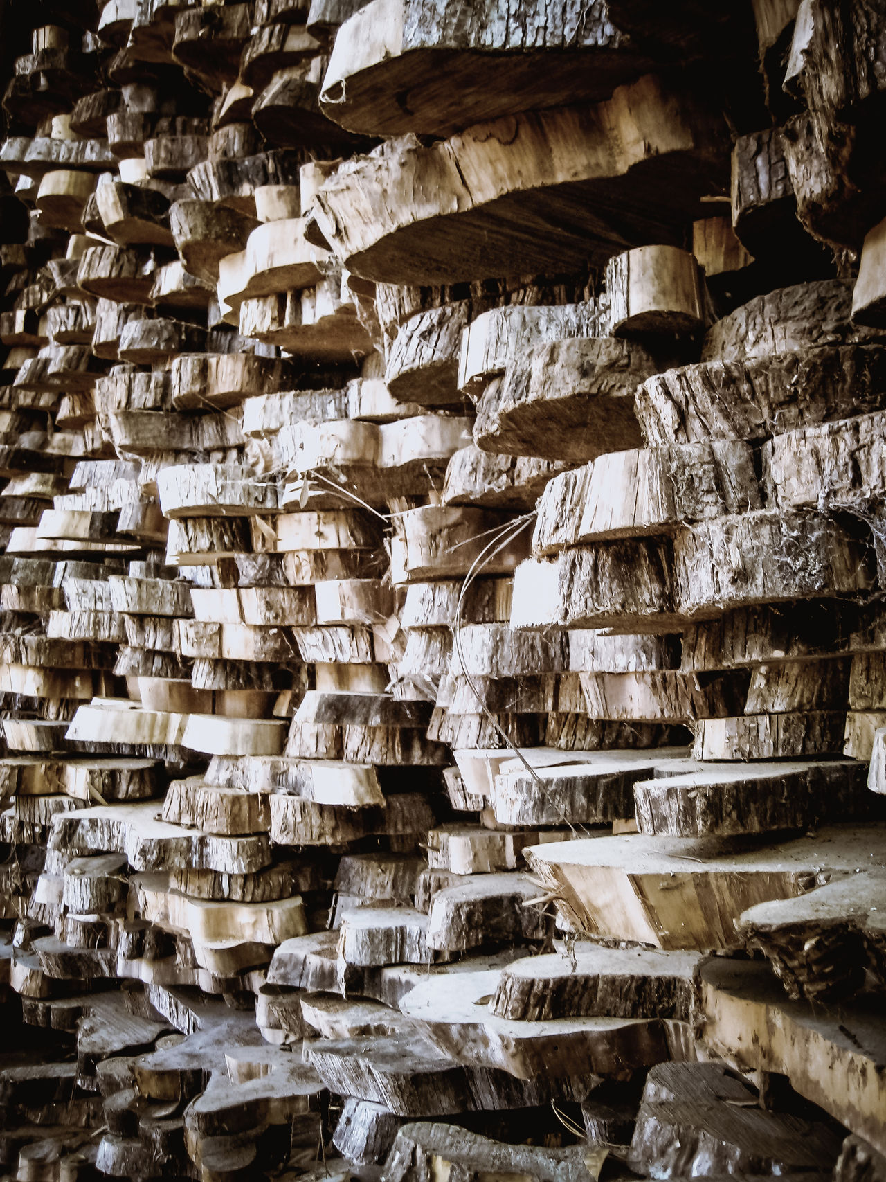 Stacks of natural live-edge Cypress tree rounds awaiting creation into furniture, crafts, and artistic endeavors. Abstract Backgrounds Brown Contrast Cypress Full Frame Large Group Of Objects Live Edge Lumber Natural Natural Pattern Nature No People Pattern Stack Texture Textured  Trees Weathered Wood Wood