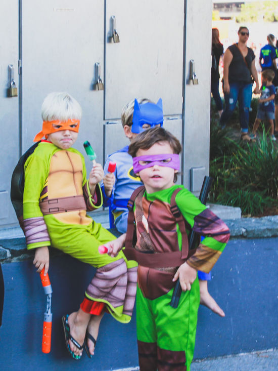 Boys Childhood Costume Day Disguise Elementary Age Face Mask Fancy Dress Friendship Full Length Halloween Happiness Leisure Activity Lifestyles Outdoors People Real People Standing Superhero Superheroes Teenage Mutant Ninja Turtles  Togetherness
