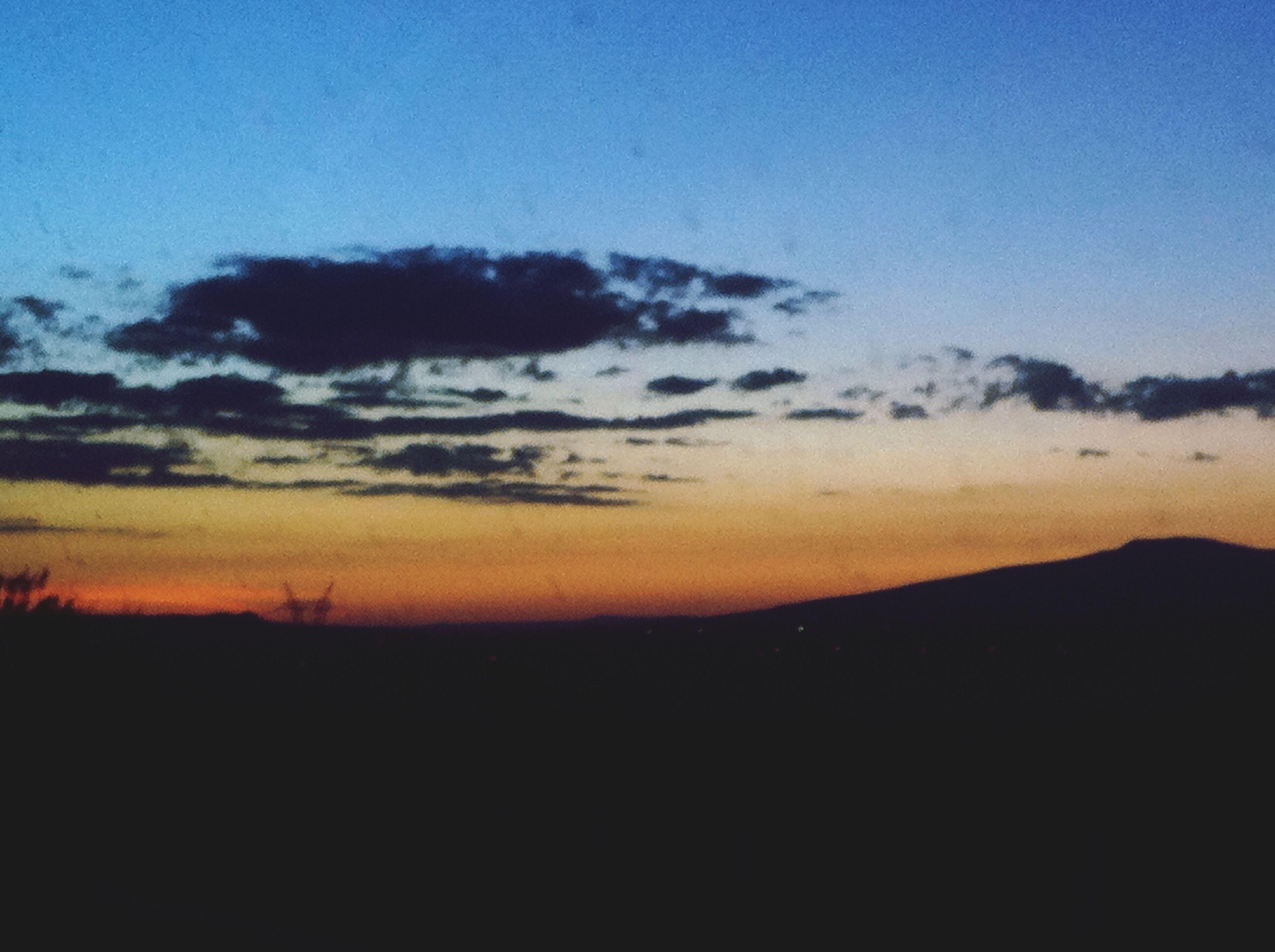 sunset, scenics, tranquil scene, silhouette, tranquility, beauty in nature, landscape, copy space, sky, nature, idyllic, mountain, dusk, blue, orange color, non-urban scene, outdoors, remote, dark, horizon over land