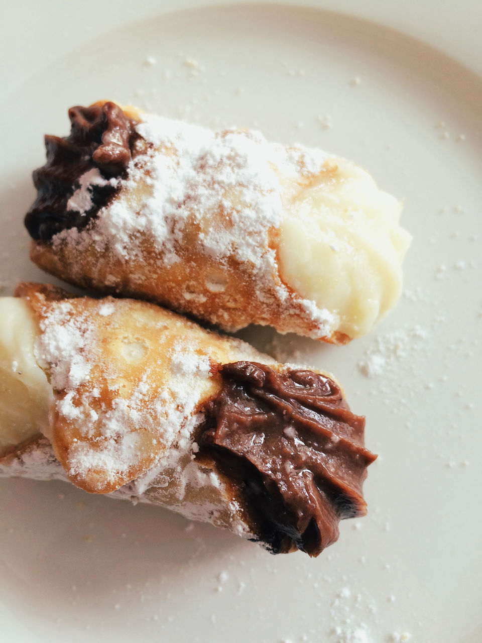 Close-Up Of Cannoli Served In Plate