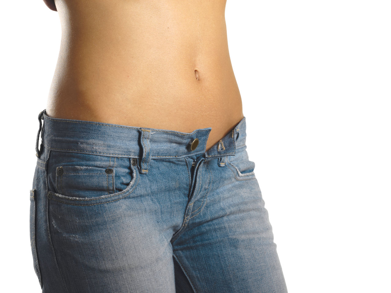 Midsection Of Slim Woman Wearing Jeans Against White Background