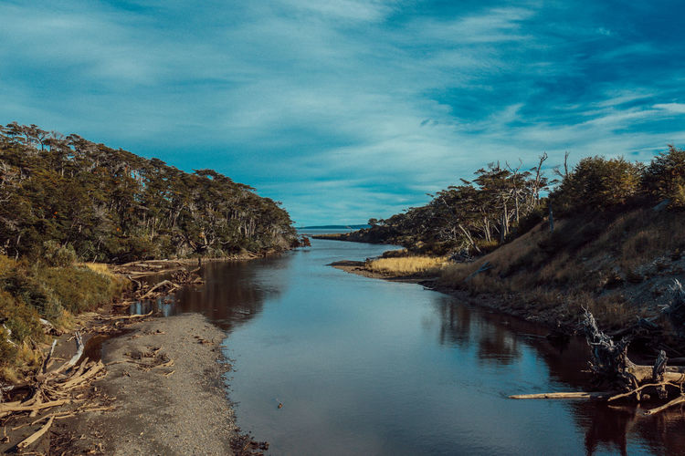Nature River View Tierra Del Fuego Travel Wanderlust Argentina Beauty In Nature Blue Cloud - Sky Day Landscape Mountain Nature No People Outdoors Rio Moat River Scenics Sky Tranquil Scene Tranquility Travel Destinations Tree Water