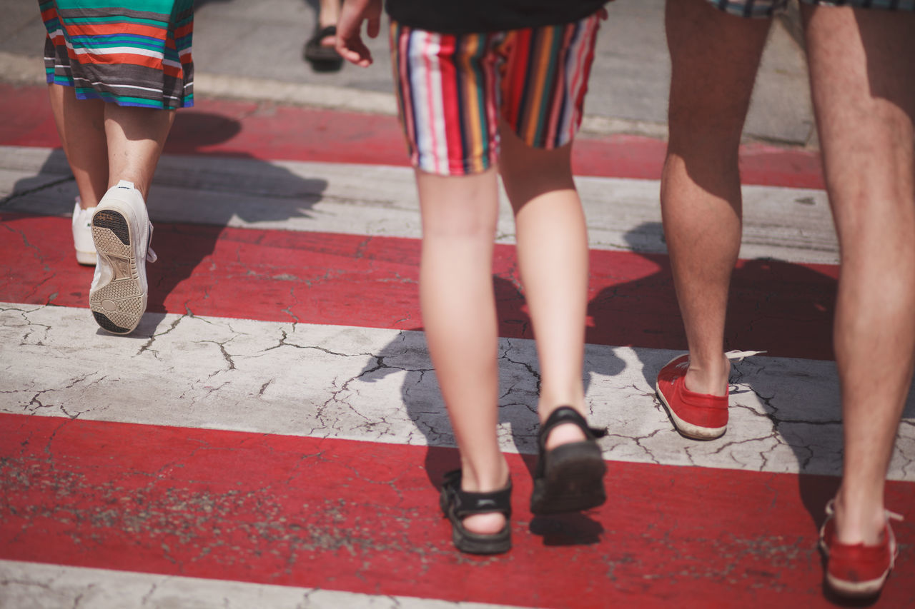 Low Section Human Leg Human Body Part Adult Young Adult Adults Only Togetherness Shoe Walking Fashion People Zebra Crossing Striped Summer streetphotography Street Photography Light Outdoors Young Women Day Men Only Women Bonding Women City