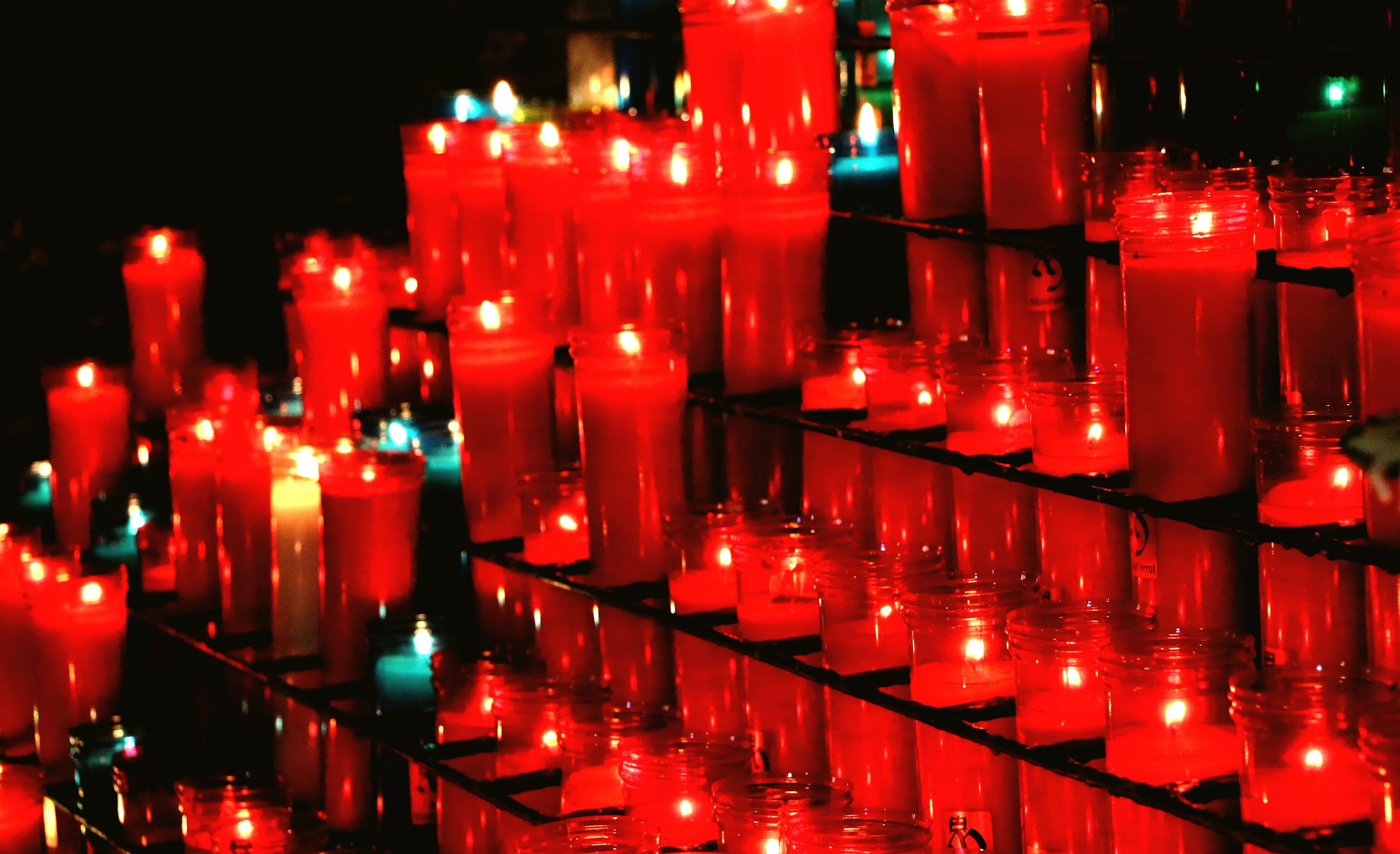 illuminated, red, candle, flame, burning, glowing, large group of objects, in a row, tea light, heat - temperature, no people, night, indoors, place of worship