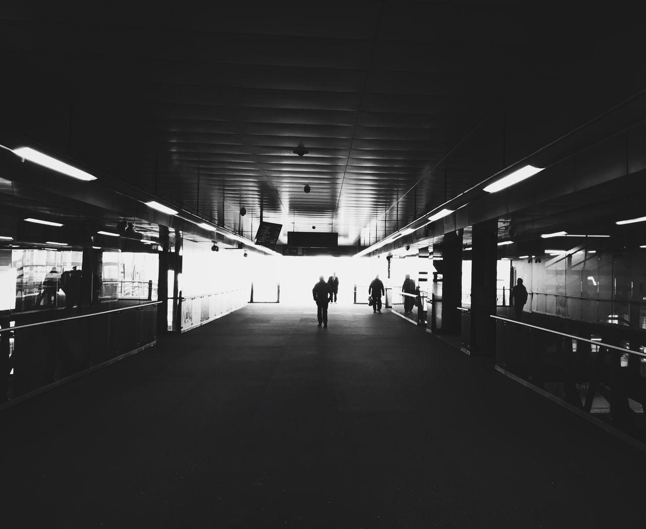Indoors  Architecture City Manchester UK Manchester Symmetry Blackandwhite Vanishing Point U.K. Subway Station Real People Illuminated Men Built Structure Full Length Public Transportation Women One Person Commuter Day