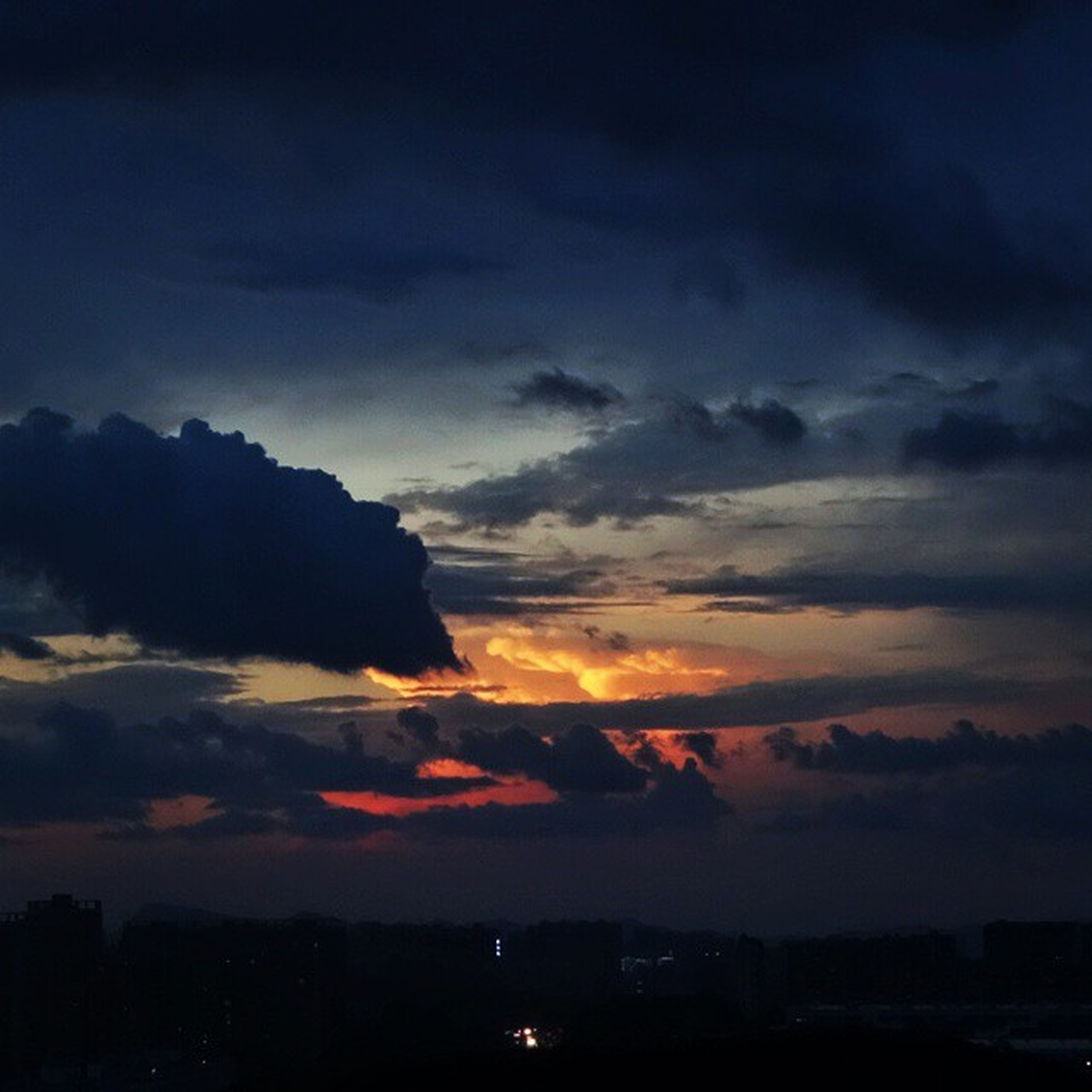 sunset, sky, cloud - sky, silhouette, scenics, beauty in nature, dramatic sky, cloudy, orange color, tranquil scene, nature, tranquility, cloud, weather, atmospheric mood, dusk, idyllic, cloudscape, outdoors, moody sky