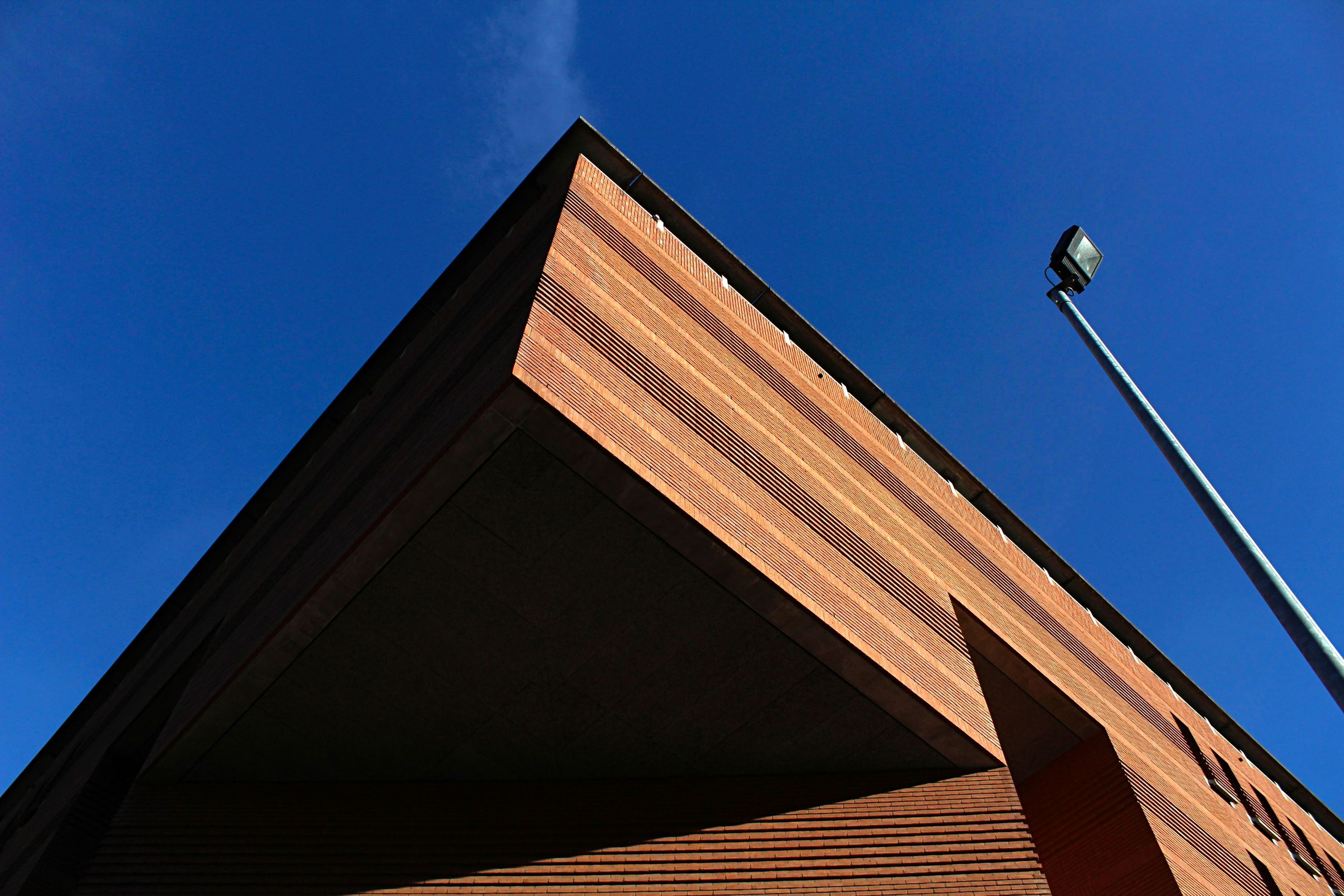 low angle view, architecture, built structure, clear sky, blue, no people, day, outdoors, building exterior, sky