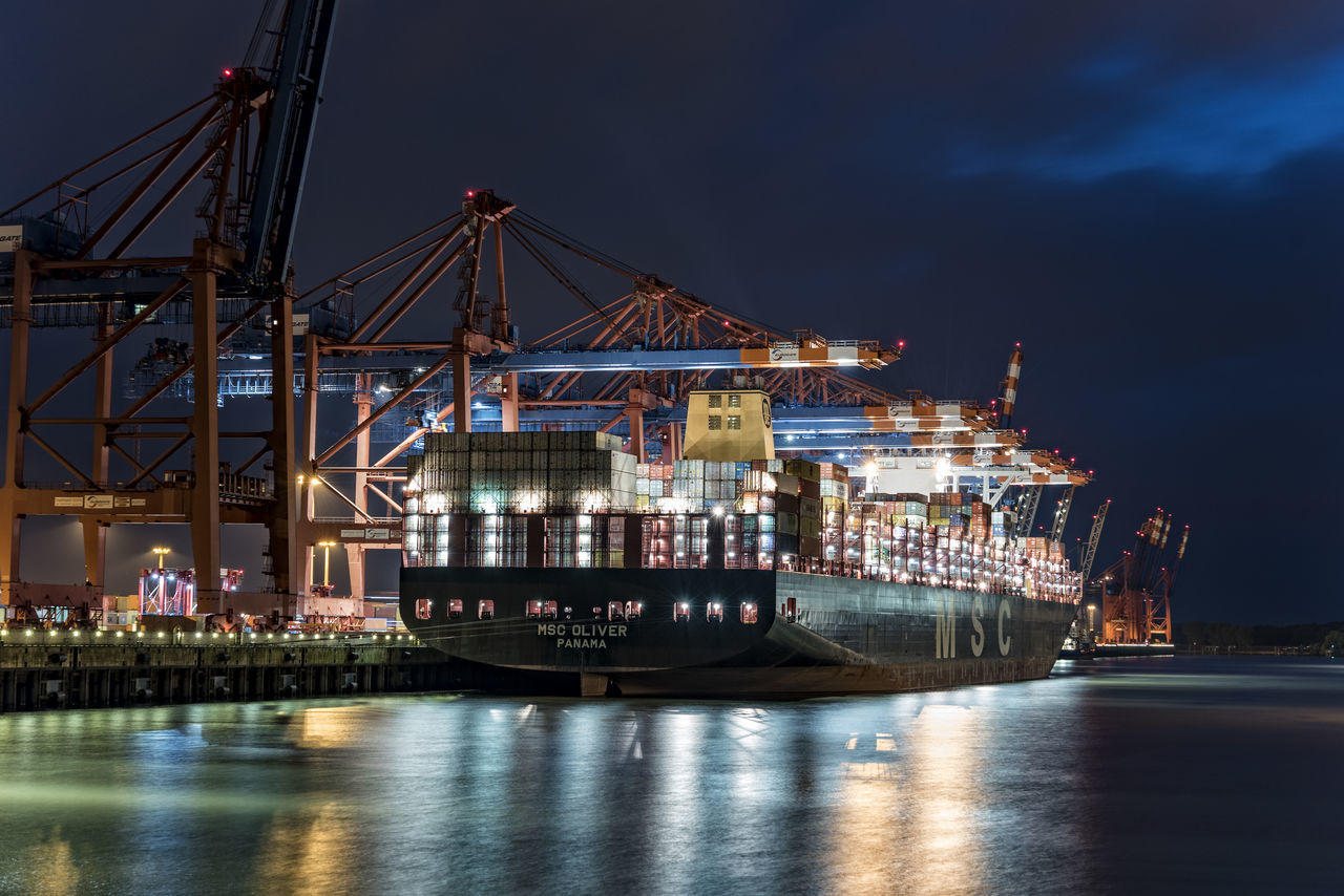 loading and unloading Cargo Container Commercial Dock Container Bridges Container Carrier Container Terminal Eurogate Crane - Construction Machinery Freight Transportation Hamburg Harbour Harbor Illuminated Industry Nautical Vessel Night Night Sky No People Outdoors Sea Shipping  Shipyard Sky Transportation Waltershofer Hafen Water Water Reflections Waterfront