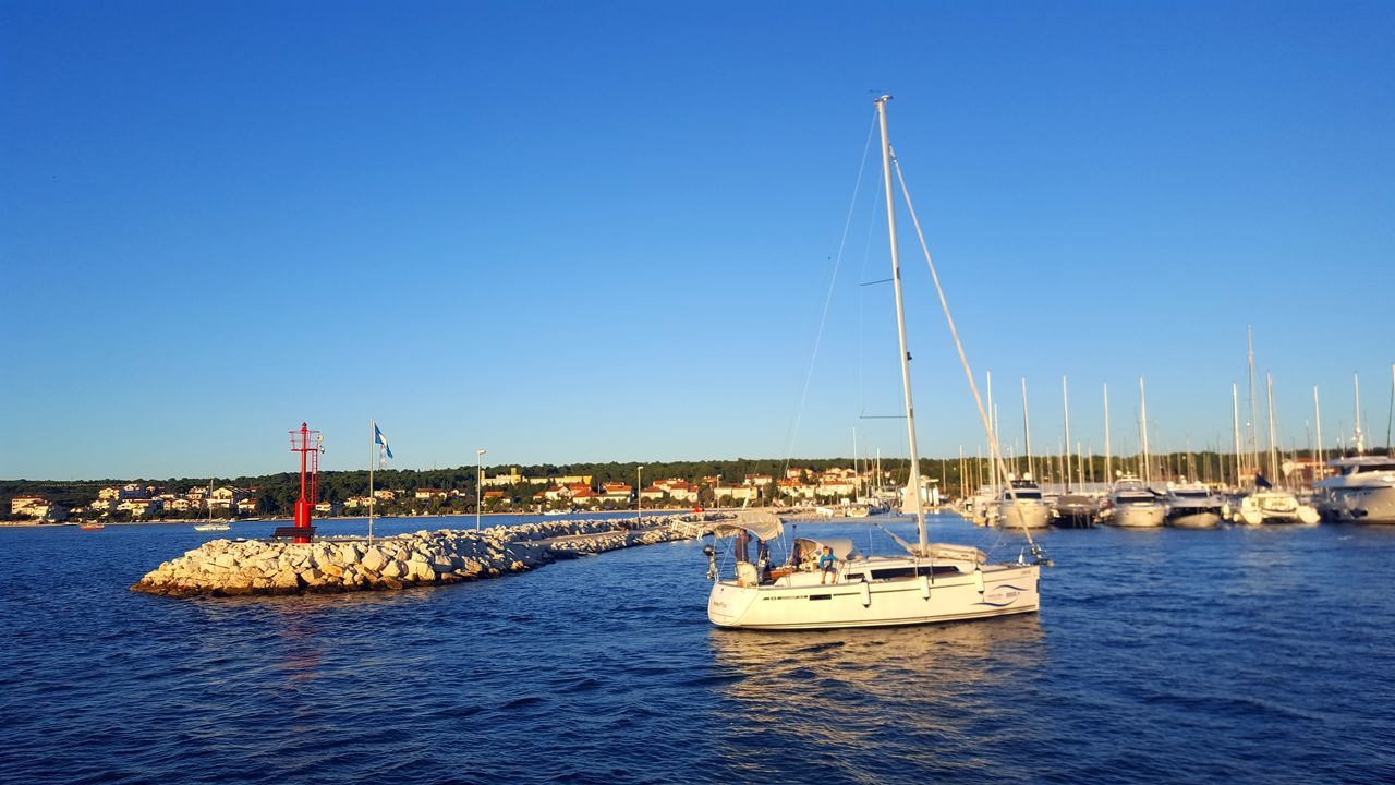 Water Sea Blue Nautical Vessel Transportation Clear Sky Sky Outdoors Harbor Sailboat Sailing Ship Sailing Yachting Tranquil Scene Idyllic