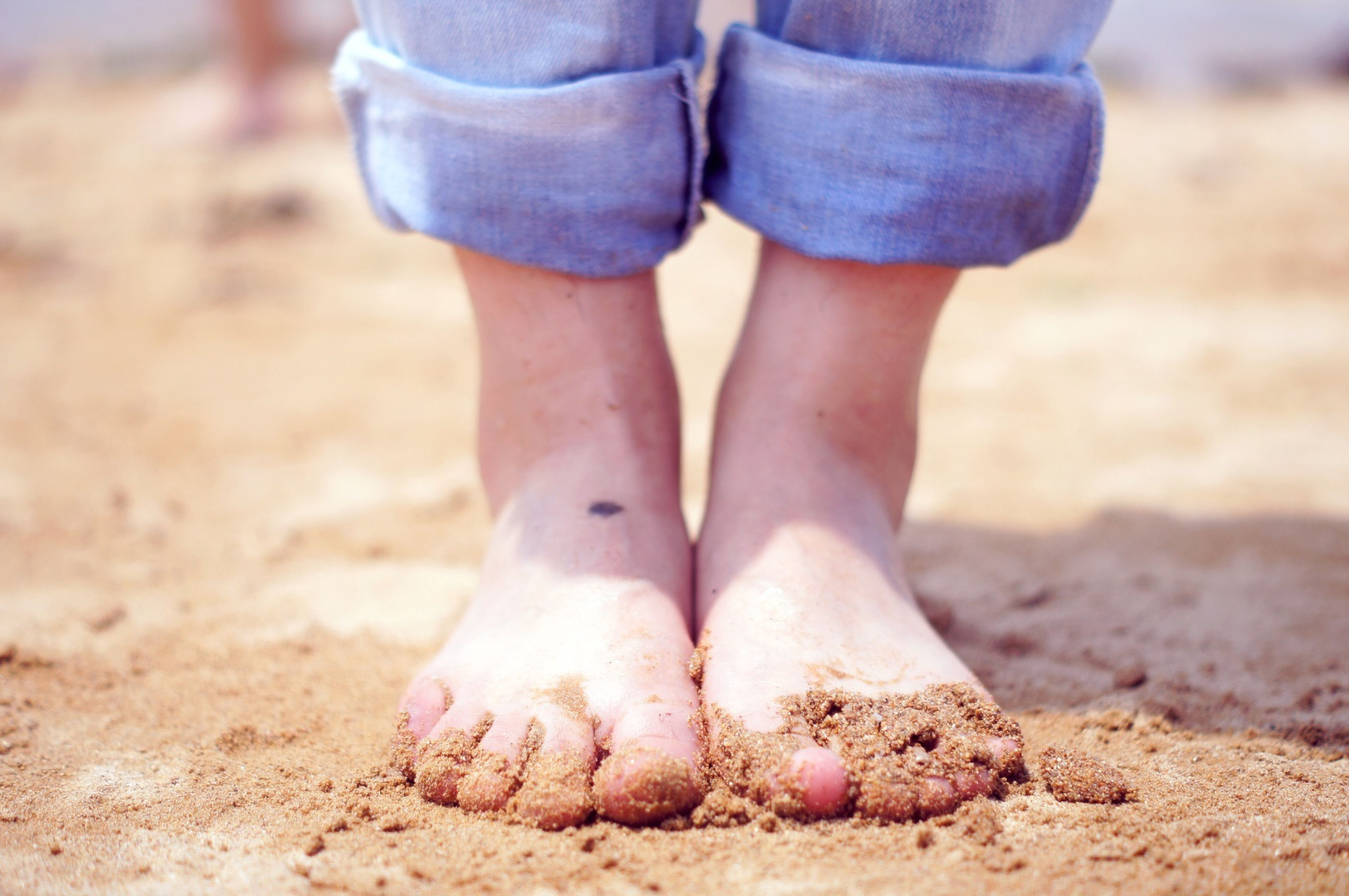sand, beach, low section, lifestyles, barefoot, leisure activity, person, focus on foreground, shore, relaxation, vacations, day, close-up, sunlight, outdoors