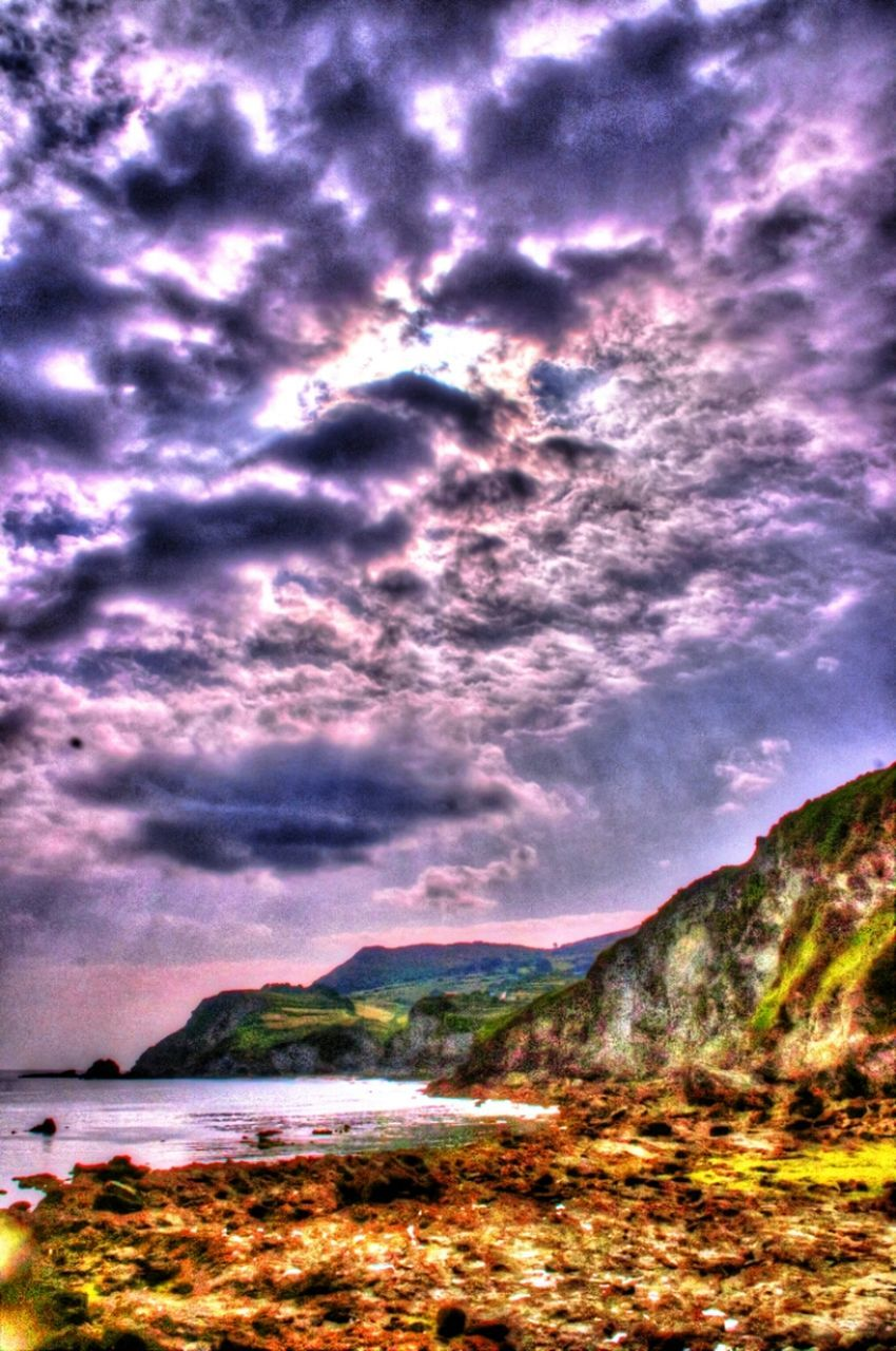 sky, scenics, water, tranquil scene, cloud - sky, beauty in nature, tranquility, cloud, overcast, nature, cloudy, atmospheric mood, mountain, dramatic sky, cloudscape, sea, non-urban scene, storm cloud, outdoors, tourism, majestic, day, coastline, remote, atmosphere, solitude, no people, mountain range