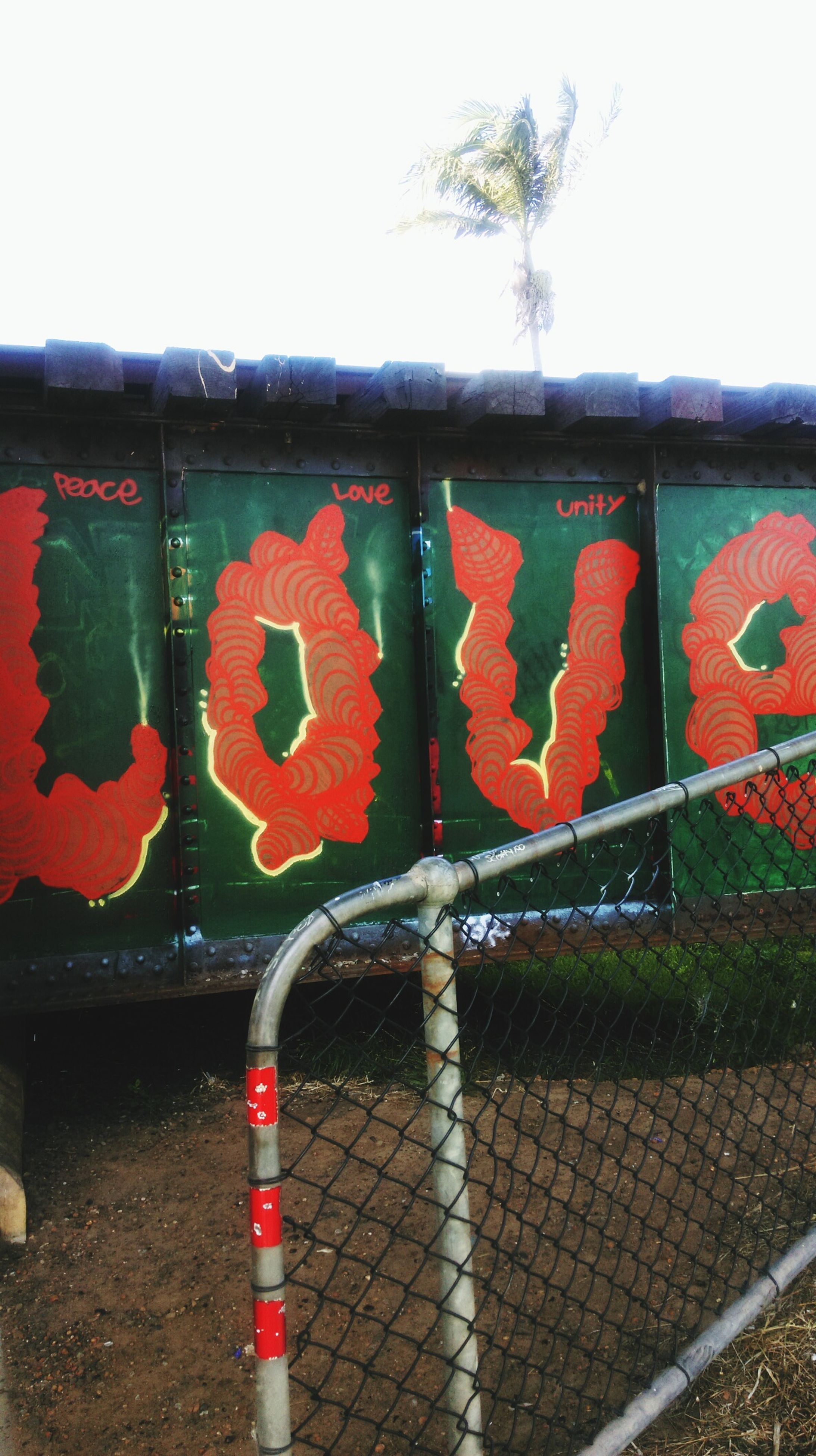 red, text, graffiti, wall - building feature, western script, communication, creativity, art, art and craft, built structure, architecture, street art, wall, day, multi colored, safety, sign, no people, outdoors, pattern