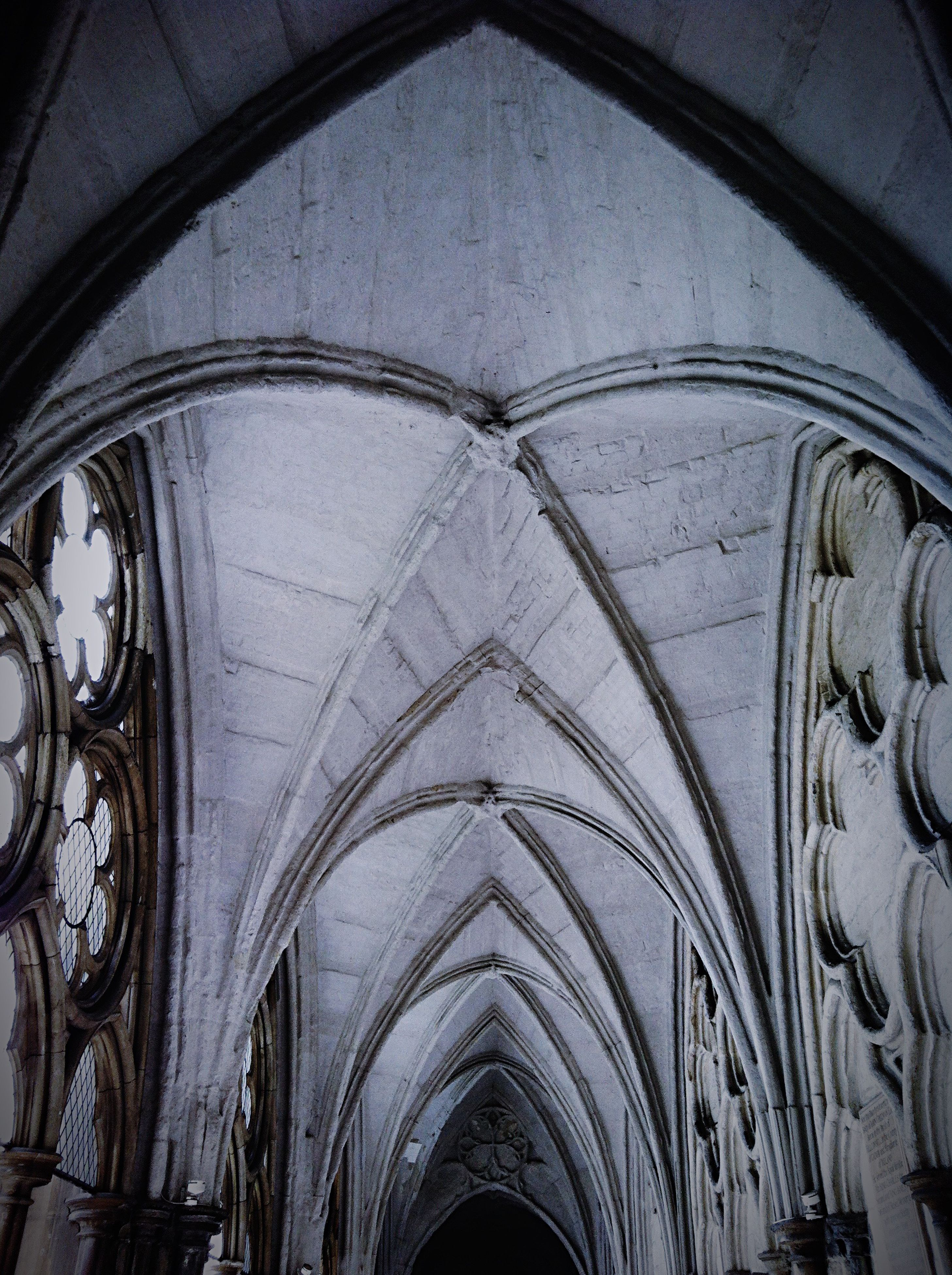 ceiling, architecture, built structure, indoors, no people, place of worship, low angle view, arch, religion, day, rose window