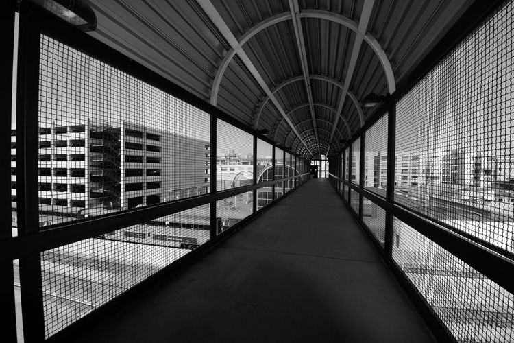 Catwalk @ Train Station 1 Jack London Square Oakland Amtrak Port Of Oakland, Ca Owns Downtown Lines: Capital Corridor,Coast Starlight,San Joaquin Tracks Owned By Union Pacific Black And White Photography Black & White Black And White Black And White Collection  Geometric Patterns Pattern Pieces Overpass Overpass View Arched Architecture