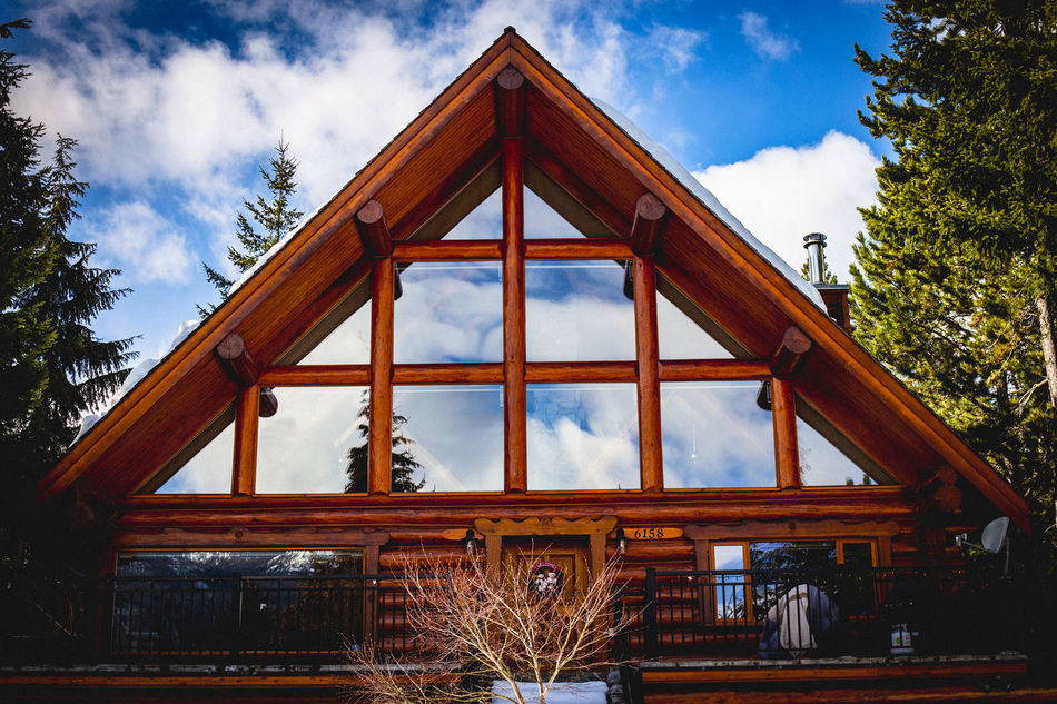 Architecture Building Exterior Built Structure Canada Close-up Cloud - Sky Day Explore Go Outdoors Home House Low Angle View Mountains No People Outdoors Outdoors Life Reflection Sky Sunny Day Tree Triangle Shape Whistler Whistlerblackcomb Window Wood - Material