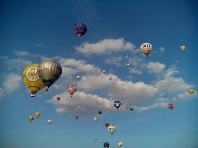 Day Hot Air Balloon Flying Sky Variation Multi Colored Cloud - Sky Ballooning Festival Mid-air Scenics Germany Warsteiner Montgolfiade 2016 Montgolfiade Blue Sky Backgrounds