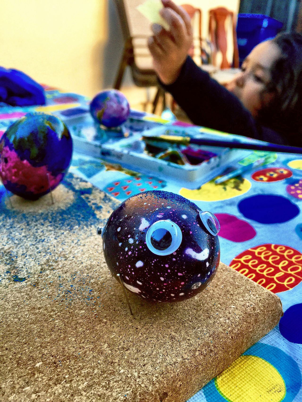 Dinosaur Easter-Egg Indoors  Table Real People Multi Colored One Person Close-up Day People Adult Egg Easter Dinosaur Egg Googly Eyes Purple Happy Cute Smile Adorable Art And Craft DIY EyeEmNewHere Crafts Art Is Everywhere The Week On Eyem EyeEmNewHere Break The Mold The Photojournalist - 2017 EyeEm Awards
