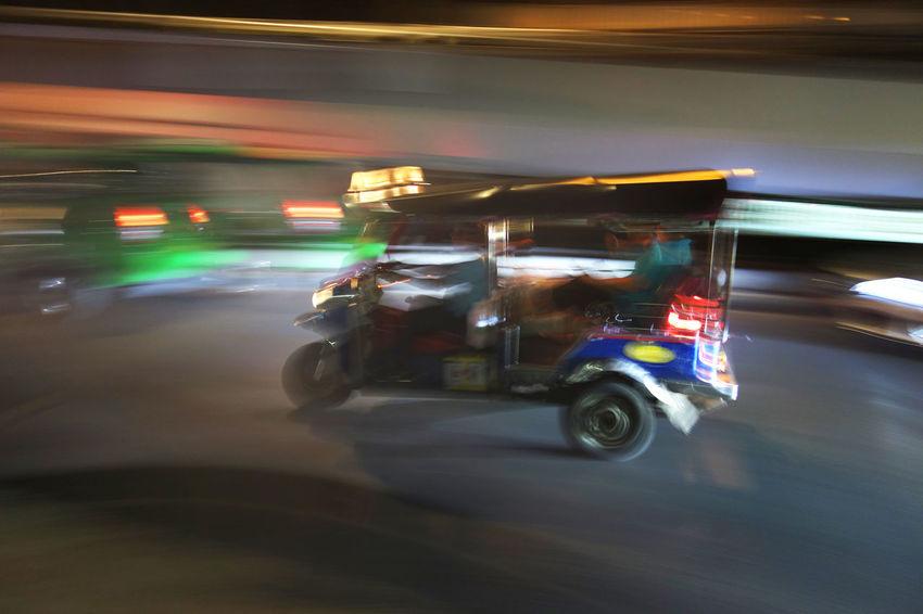 blurred motion on tuktuk on the read in Bangkok Driving Fun TukTuk Blurred Motion Exciting Illuminated Land Vehicle Mode Of Transport Motion Night Road Speed Tourism Transportation