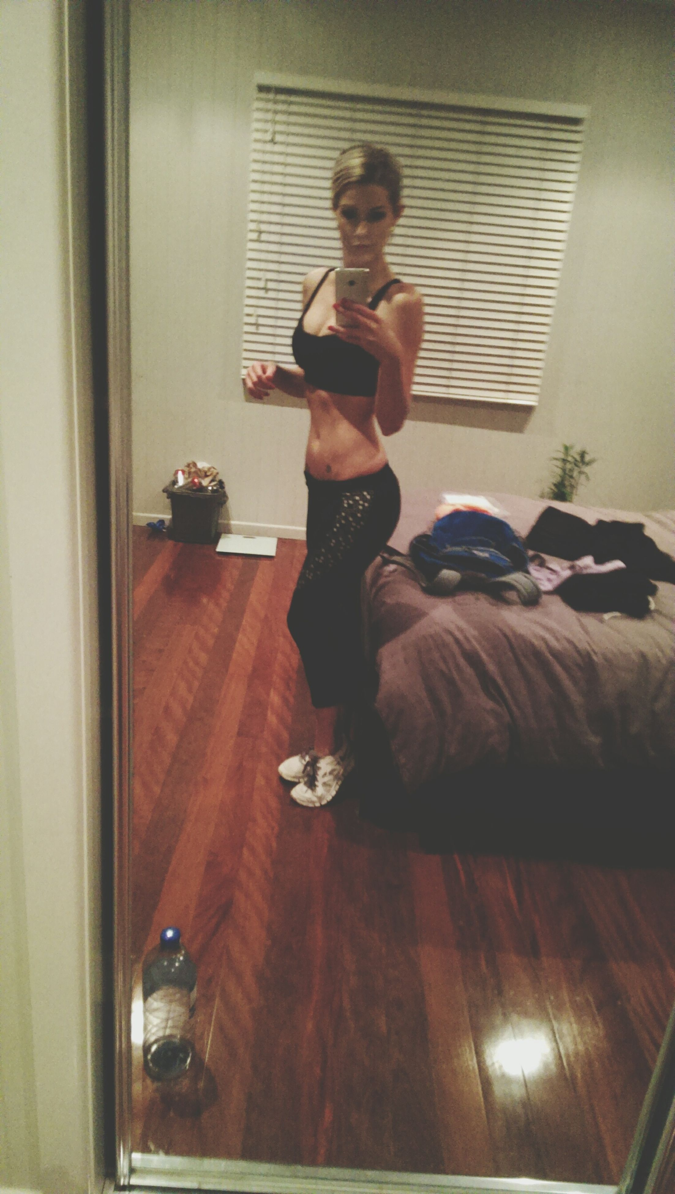 indoors, full length, young adult, lifestyles, person, casual clothing, home interior, leisure activity, young women, sitting, front view, three quarter length, mirror, looking at camera, window, standing, domestic room, door