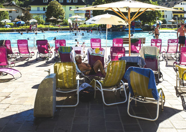 summer in the city Chair City Life Day Enjoying Life Everyday Joy Everyday Lives Eyeemphoto Life Is A Beach Light And Shadow Outdoors People Photography Pool Relaxing Shadow Sitting Summertime Sunshine Swimming Swimming Pool Urban Lifestyle Water