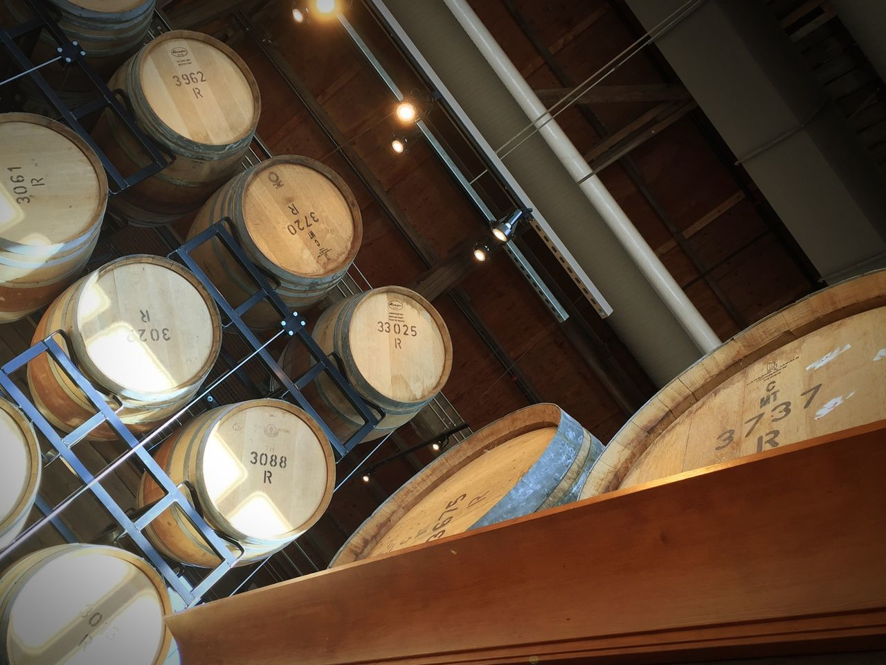 Low Angle View Of Wine Barrels In Cellar