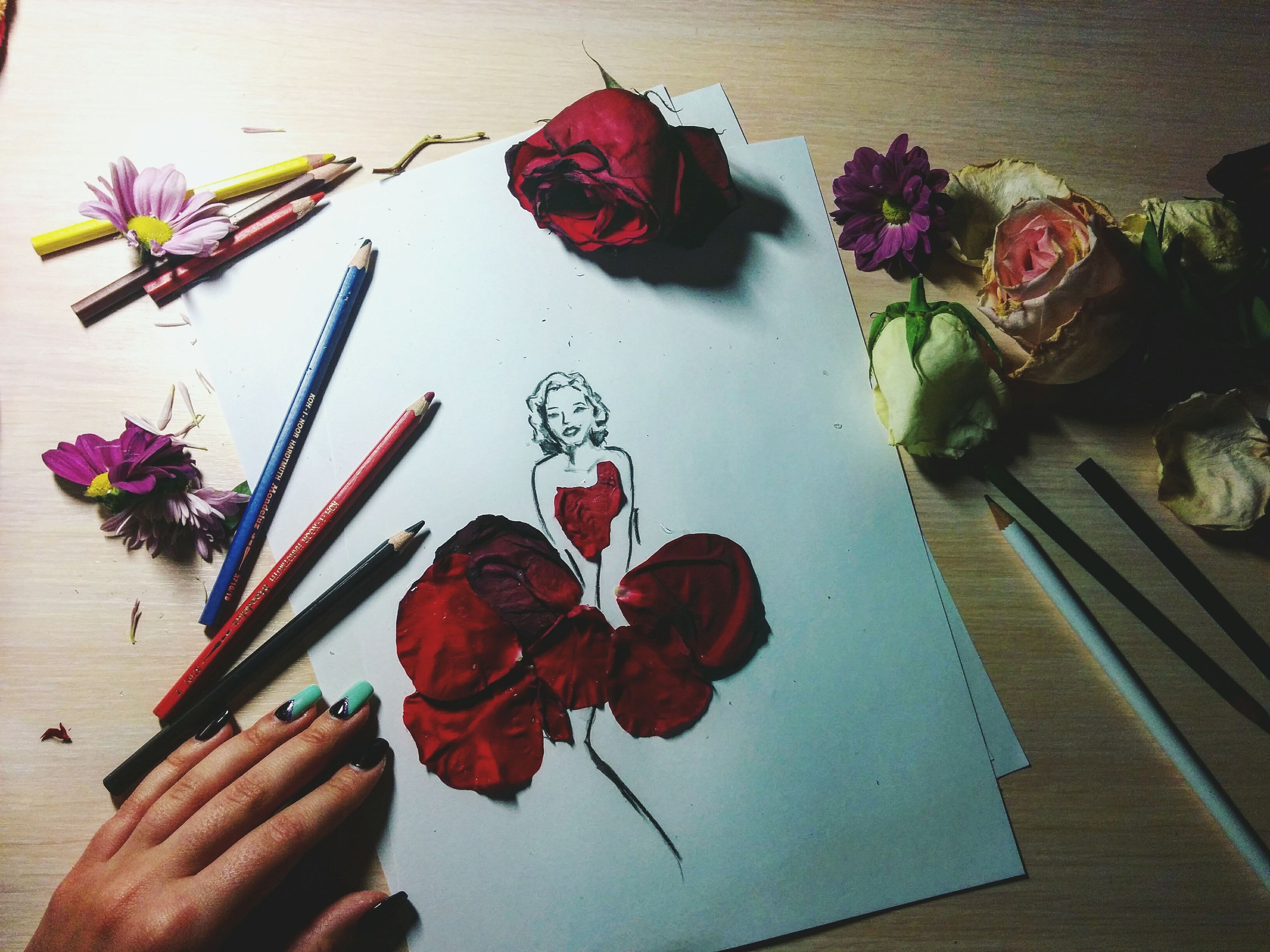 person, indoors, flower, holding, part of, freshness, table, paper, cropped, high angle view, bouquet, creativity, art, decoration, human finger, unrecognizable person, vase