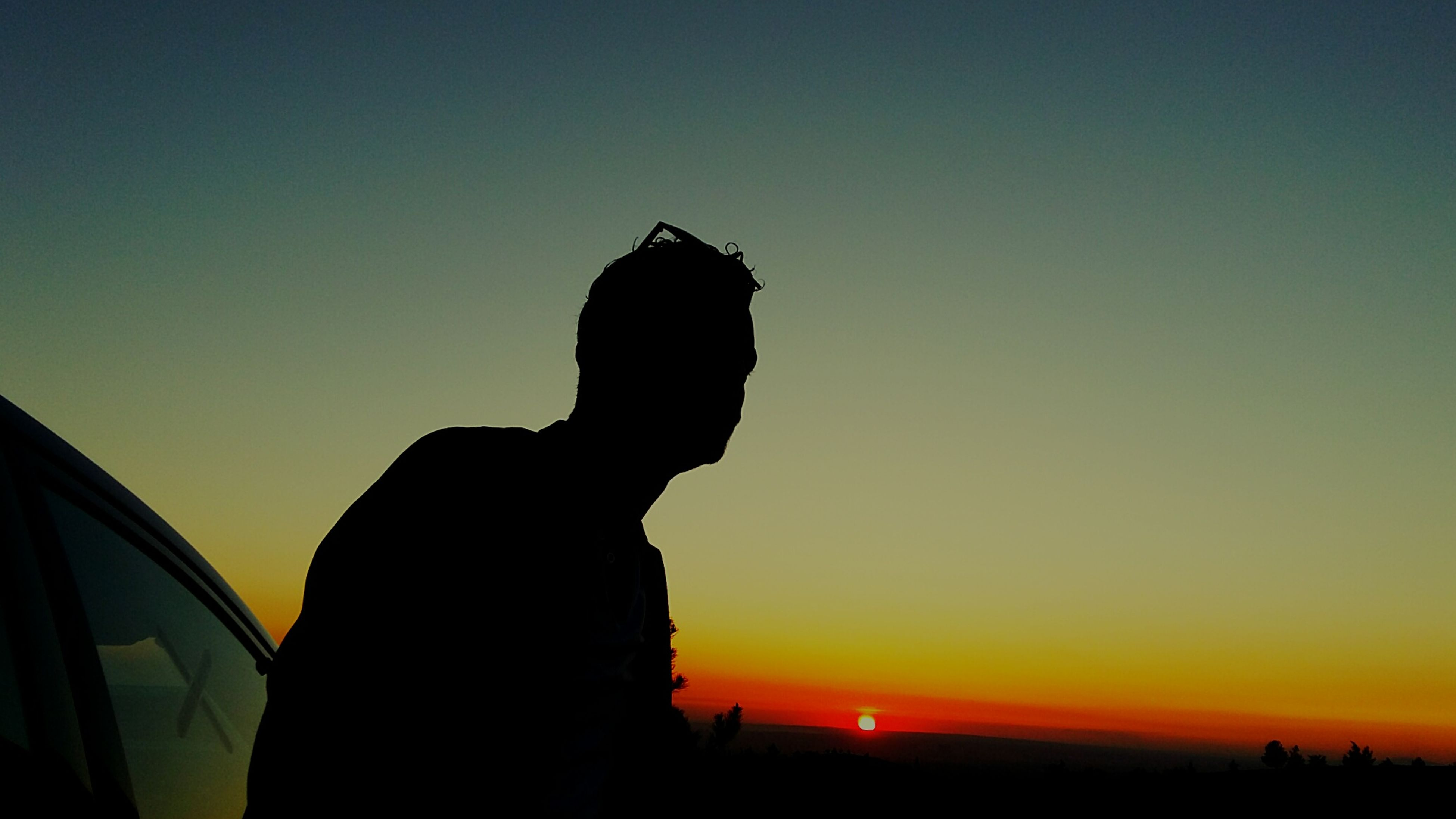 silhouette, sunset, copy space, clear sky, orange color, sky, outline, beauty in nature, nature, tranquility, sun, dusk, low angle view, outdoors, tranquil scene, back lit, scenics, dark