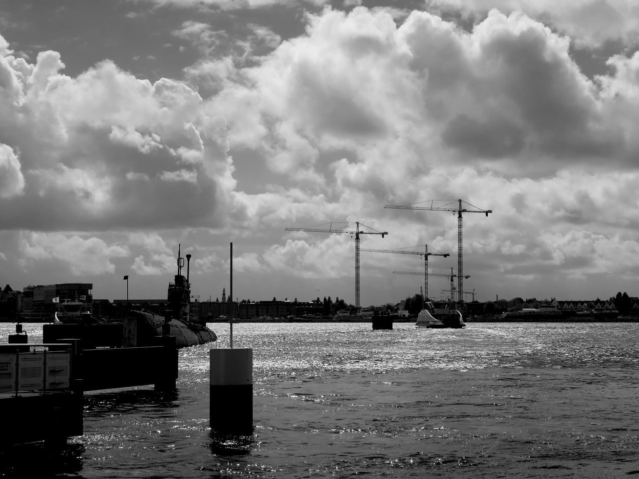 Hollandse wolkenluchten - Dutch skies, in black and white Amsterdam B&w Black And White Black And White Photography Cloud - Sky Clouds And Sky Construction Crane Crane - Construction Machinery Day Dutch Skies Ferry Ferryboat Harbor Ij Nautical Vessel No People Outdoors Pont River View Riverside Sea Sky Skyline Submarine Water