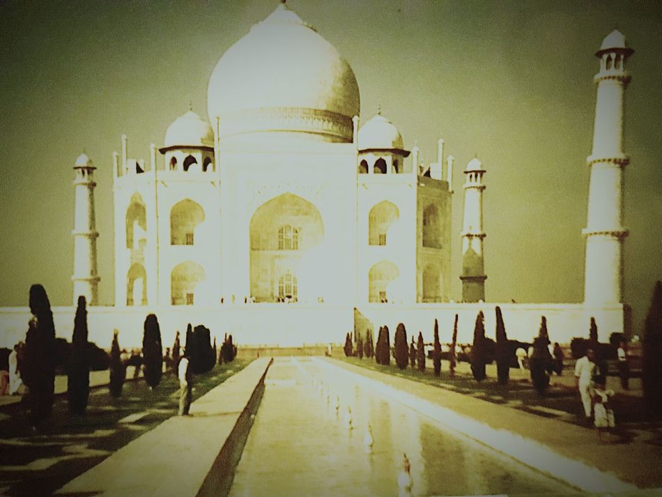 Travel Destinations Architecture Dome Built Structure Building Exterior Travel History Sunlight Cultures Memorable Wonders Of The World Manmade Beauty Taj Mahal India Wonderful Place When Two Different Worlds Collide Indian Culture  Backgrounds Taj Mahal Vintage Photo Long Goodbye