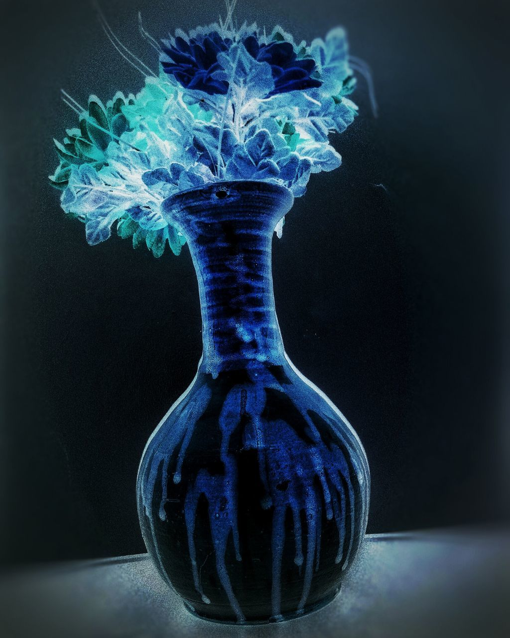 no people, table, black background, studio shot, blue, close-up, indoors, day