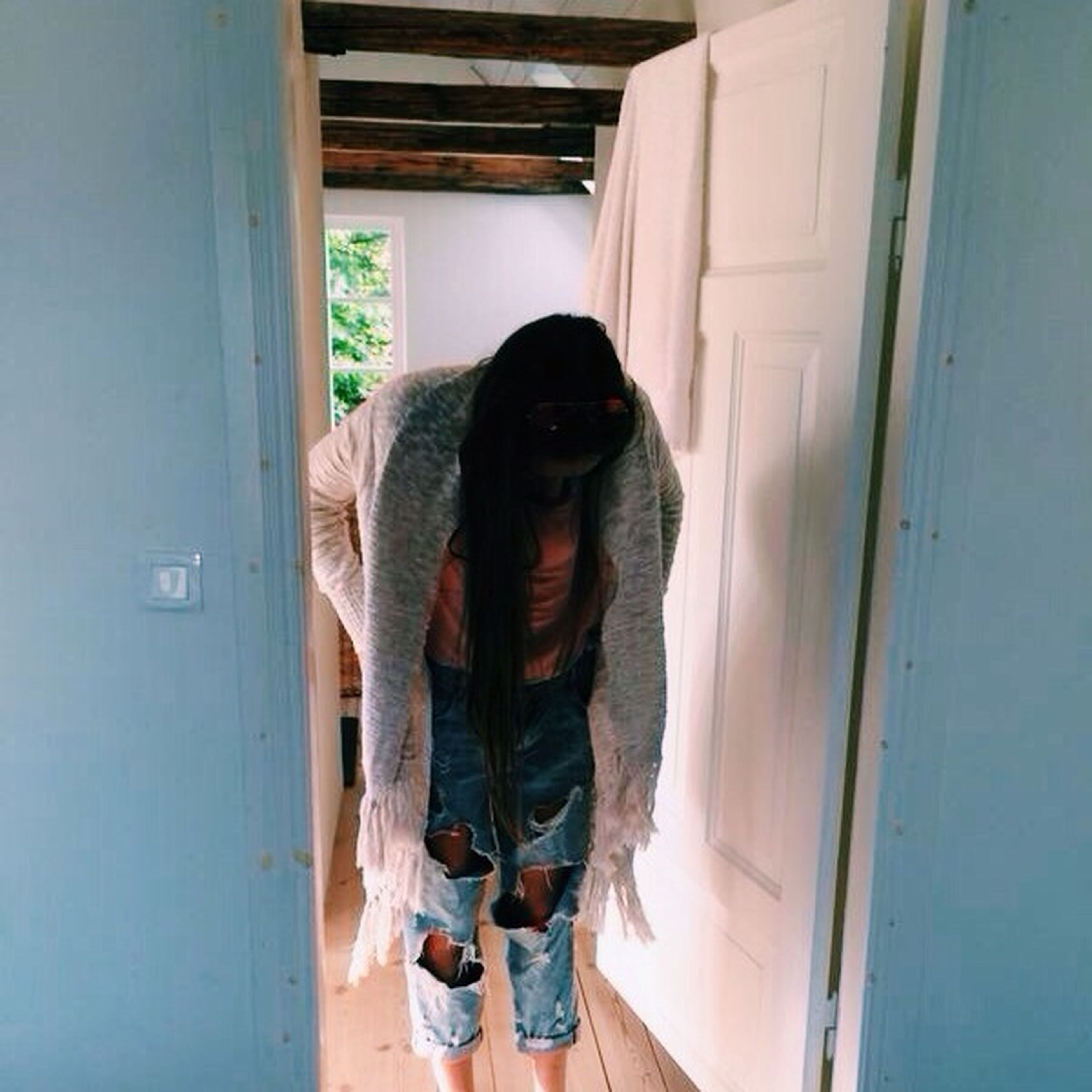 lifestyles, indoors, standing, leisure activity, casual clothing, rear view, young adult, person, full length, men, three quarter length, door, young women, window, side view, day, long hair, sitting