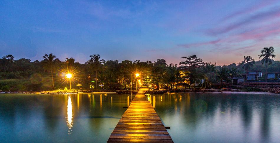 Sunrise at the Beach Resort, Koh Kood, Trat, Thailand Beauty In Nature Blue Cloud - Sky Diminishing Perspective Idyllic Illuminated Koh Kood Nature No People Outdoors Reflection Scenics Sky Thailand Tranquil Scene Tranquility Trat Trat,Thailand Tree Water