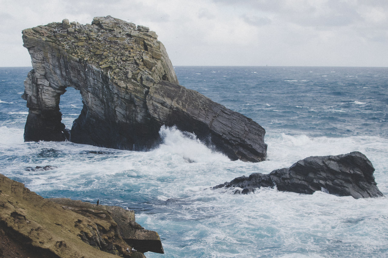 Gaada Stack Atlantic Ocean Beauty In Nature Day Horizon Over Water Island Island Life Landscape Natural Arch Nature Nesting Birds No People Outdoors Power In Nature Rock - Object Rock Formation Scenics Sea Seascape Travel Water