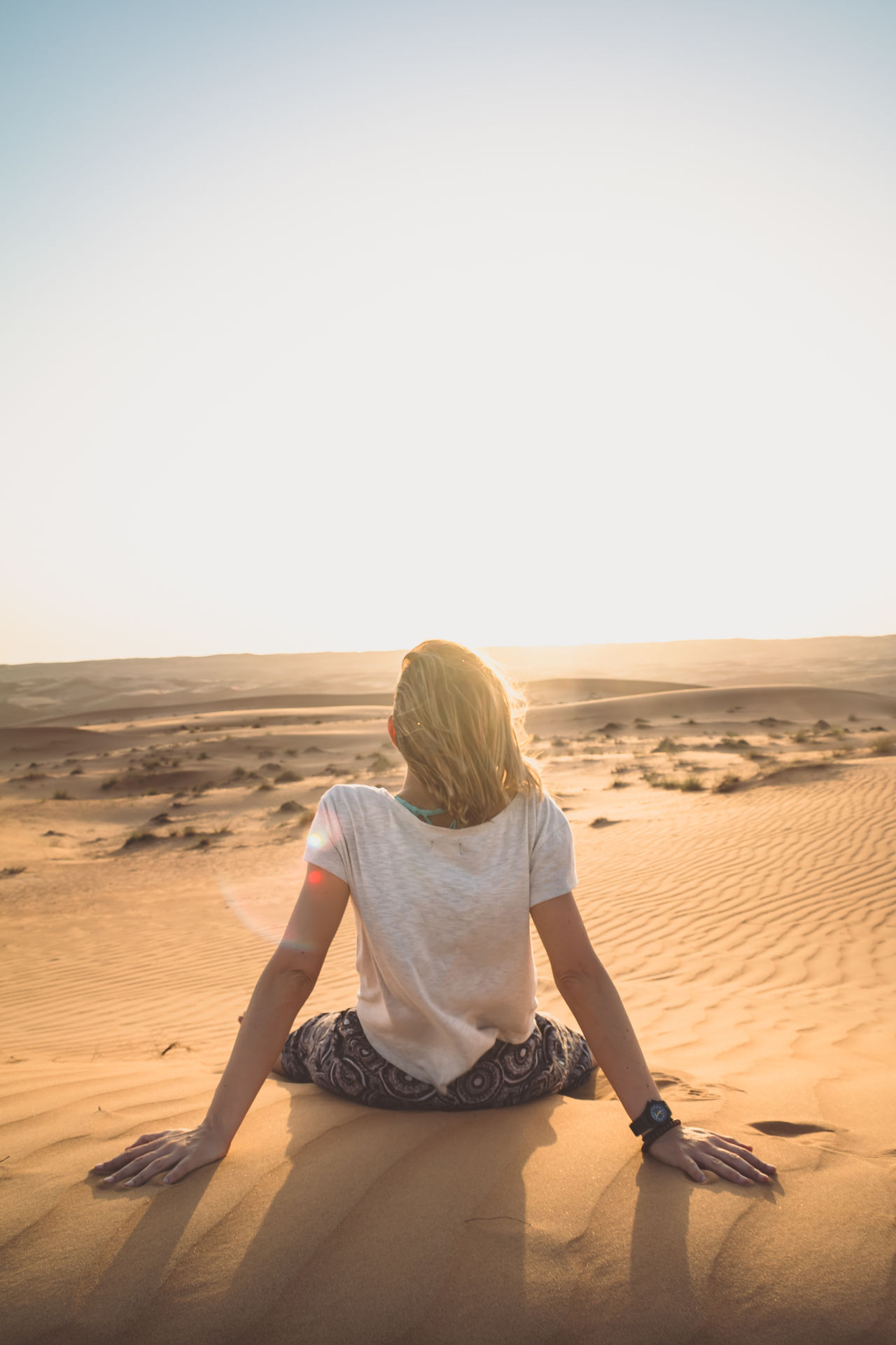 Arid Climate Clear Sky Day Desert Desert Landscape Nature Oman One Person One Woman Only Rear View Relax Sand Sand Dune Scenics Shadow Sky Sunlight Sunset Wahiba Sands Women Live For The Story