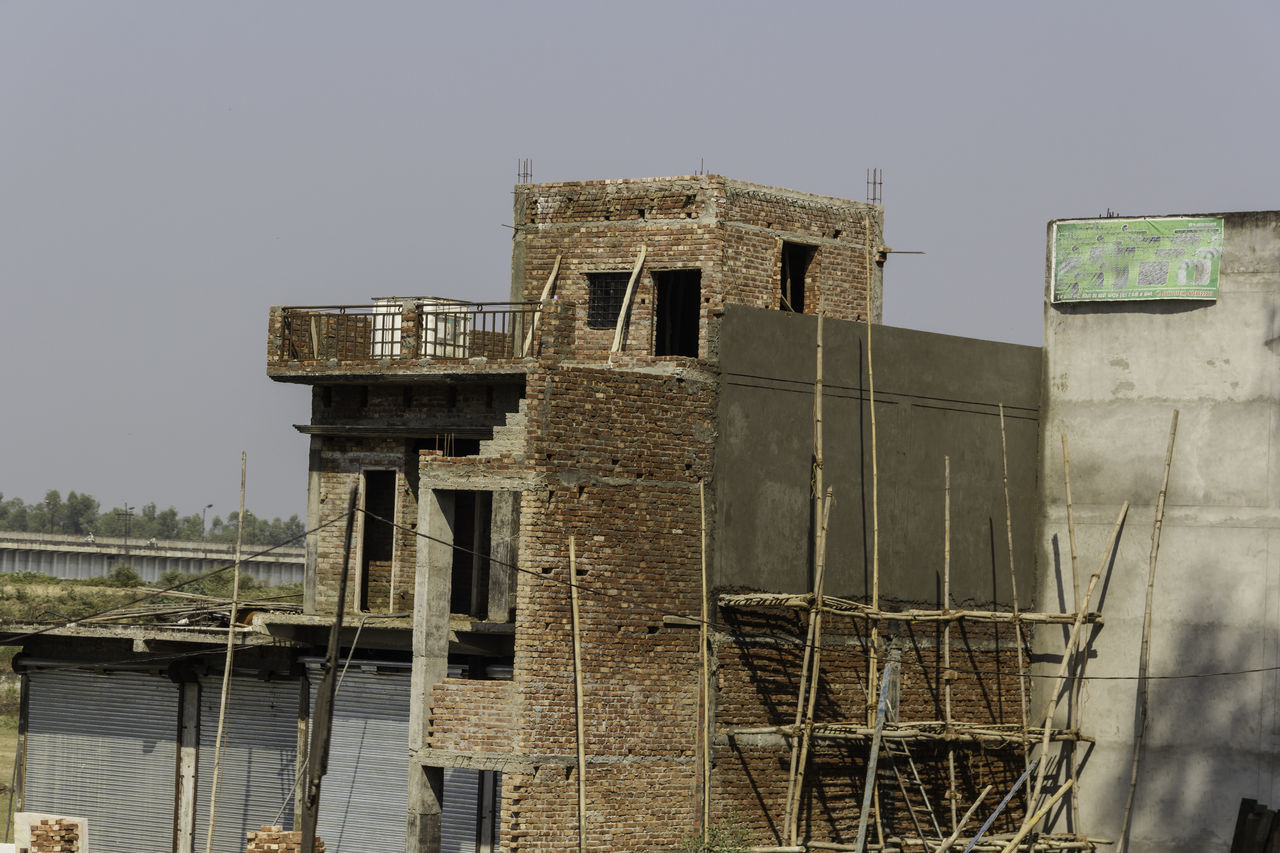 A building under construction on the outskirts of the city of Roorkee. Bamboo poles are used for support and for supporting a roof when it is being paid, and most of the brick work is in the process of being done and with the RCC pillars forming the superstructure of this building. Brick Building Brick Work Building Under Construction Built Structure Cement Pillars India No People Outdoors RCC Pillars Sky Under Construction Under Construction Building