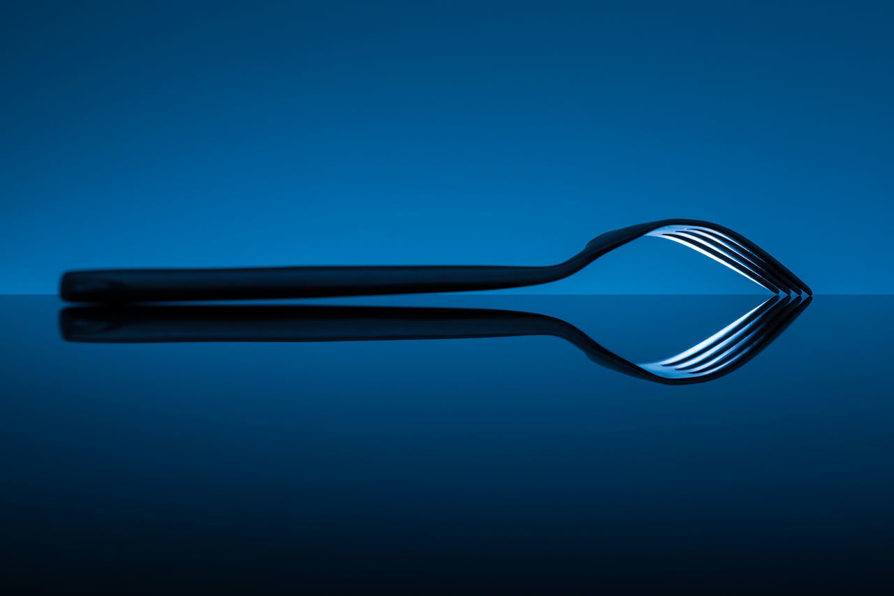 studio shot, single object, blue background, copy space, blue, no people, colored background, close-up, day