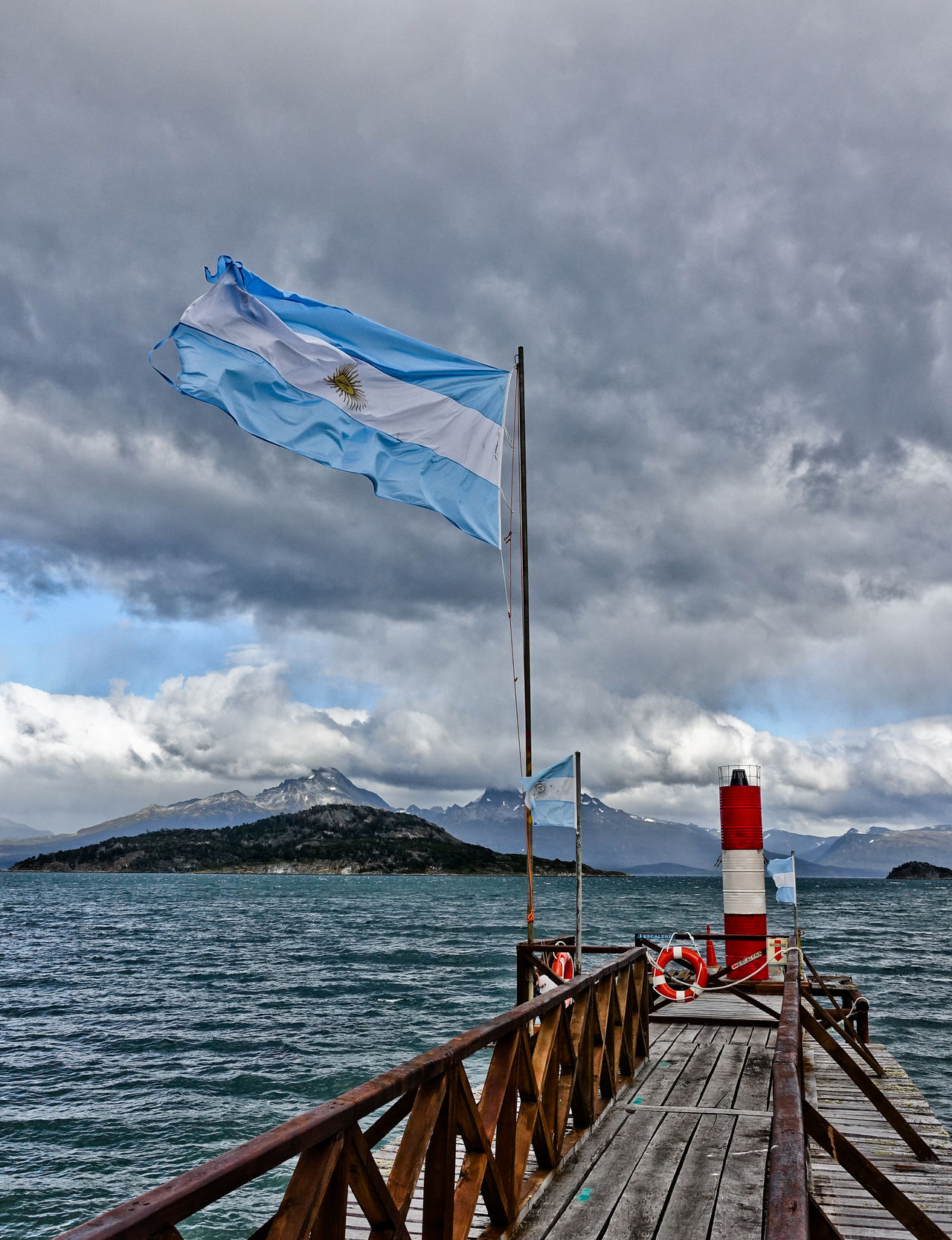 Architecture Beauty In Nature Cloud - Sky Day Flag Mountain Mountains Nature Nautical Vessel No People Outdoors Pier Scenics Sea Sky Tierra Del Fuego Tranquility Ushuaïa Water
