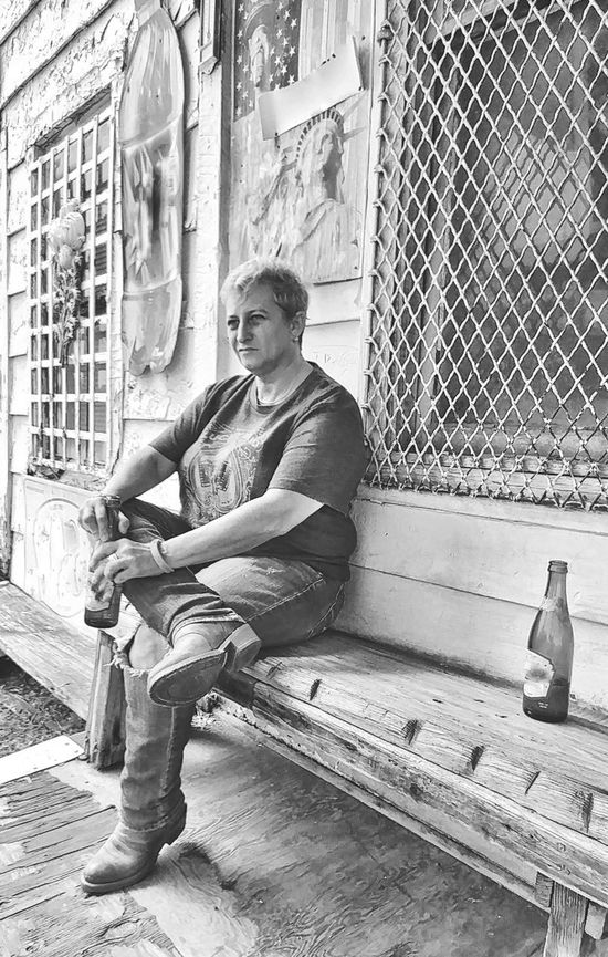 Sitting One Person Outdoors Day Arts Culture And Entertainment Full Length Only Women Preston , Kentucky The Week On EyeEm Lgbt Community Cowboy Boots Real People Building Exterior Appalachia Casual Clothing Blond Hair Country Store Porch Architecture Blackandwhite Photography Black And White Friday EyeEm Ready   EyeEm Ready