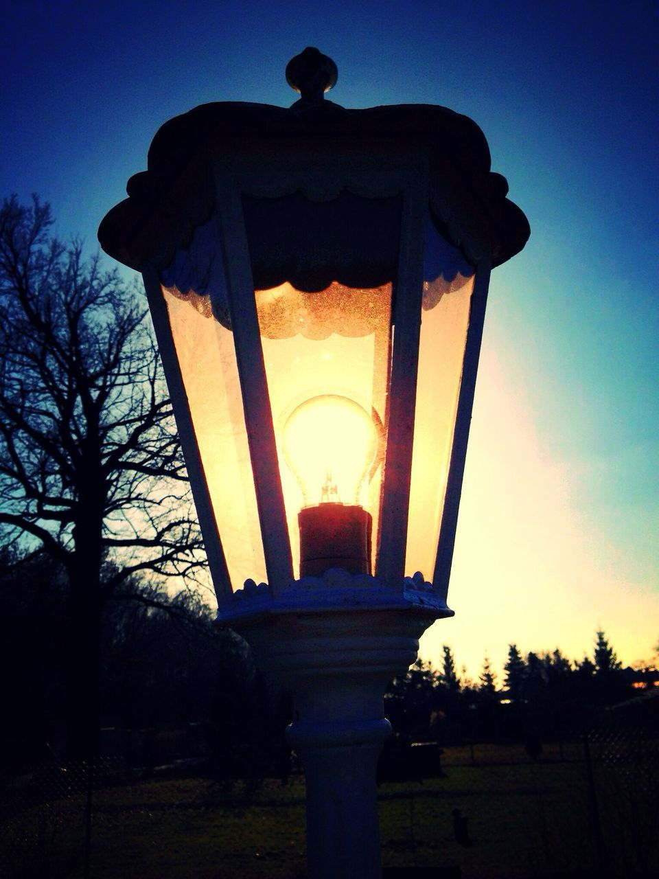 Close-Up Of Illuminated Street Light During Sunset
